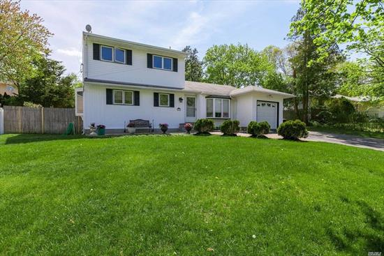 This 5 Br Colonial Features A Custom Granite Eik W/Brand New Ss Appliances, Beautiful Open Floor Plan, Main Floor Master Br Suite, Main Floor Laundry, Hw Floors, Finished Basement, Gas Heat, Central Air Conditioning, New 200 Amp Elec, Vinyl Siding & Igs! Set In The Desirable Morewood Neighborhood Of Smithtown! Accompsett Elem & Middle School & Hs West!