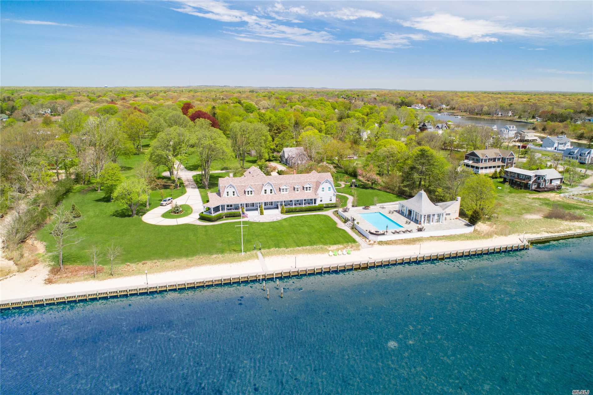 Spectacular 10, 000 Sqft 8 Acre Bayfront Estate Overlooking Moriches Bay Offering 425 Ft Of Water Frontage And Private Beach! A True Entertainers And Boaters Paradise Offering Panoramic Views And Wide Open Bay And Ocean Access . Main House Offers 14 Beds, 17 Baths, Multiple Entertaining Spaces, Large Oversized Kitchen, Library, Formal Dining Room And Wrap Around Porch. Enjoy Privacy Galore And Summer Like No Other With Your 20X50 Ft Heated Saltwaterpool And Glass Enclosed Pagoda Style Pool House.