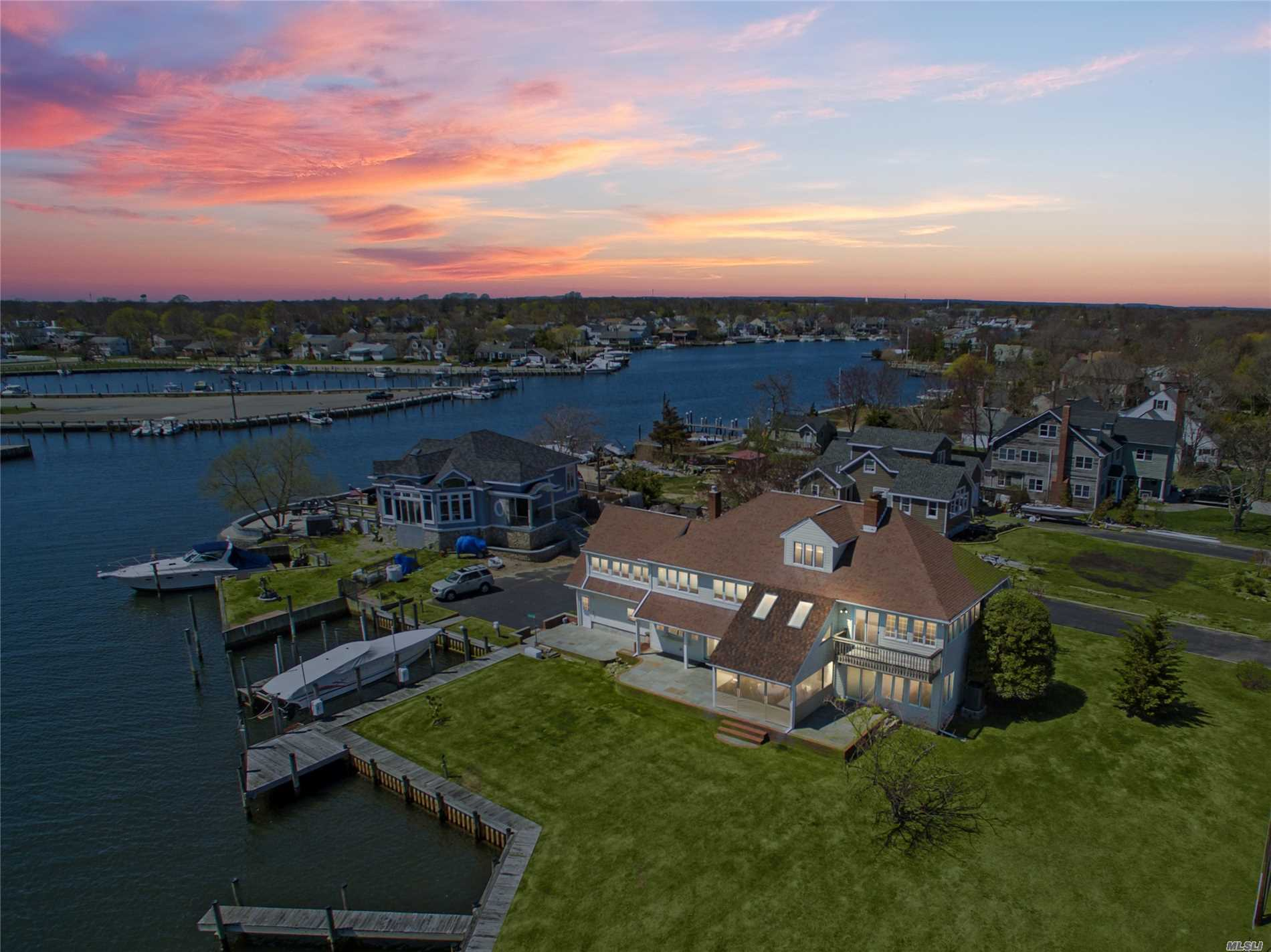 Spectacular Bayviews From This Waterfront Home W/295' Bulkhead (245' Navy Sealock) & 175' Finger Piers W/5 Slips. Superb 4 (Poss 5) Bedrooms & Den, 2.5 Bath Updated Boaters' Paradise Oak Flrs On 1st Floor & Lush Carpeting On 2nd. Master Suite W/Bath & Gas Fireplace (3 Total) Plus 22'X24' Rec Room Just Part Of Spacious 2nd Floor. Fantastic Views From Virtually Every Room, Including Crow's Nest. Entertain Inside & Out On Grand .44 Acre. New Gas Heat & Cac. Check Out Aerial Virtual Tour Attached