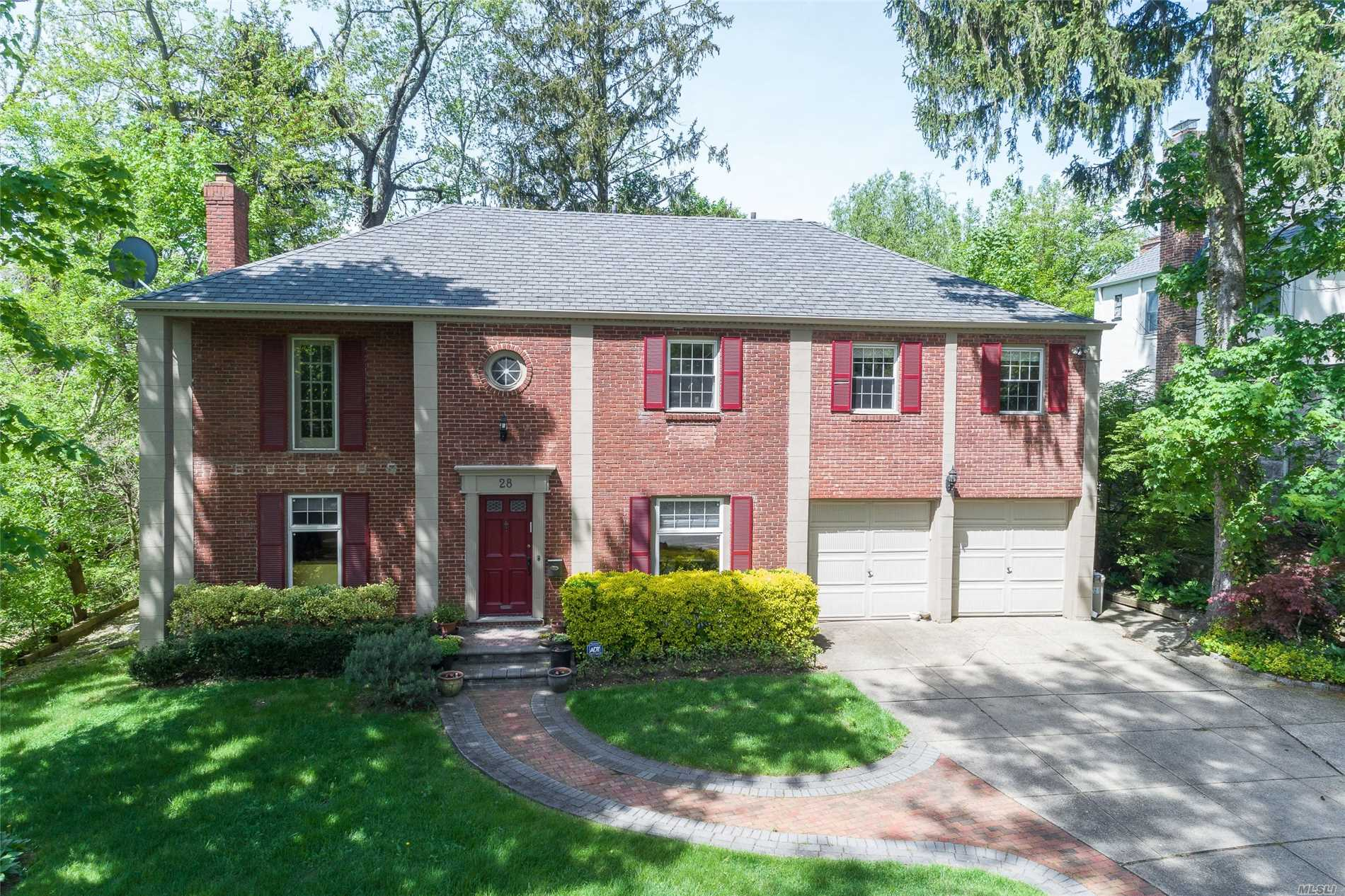 Spacious Brick Center Hall Colonial Within Walking Distance To Shopping, Houses Of Worships, Schools And Transportation. Brand New Eat-In-Kitchen With S/S Appliances,  New Roof, New Hot Water Heater, 2-Car Attached Garage And Full Basement.