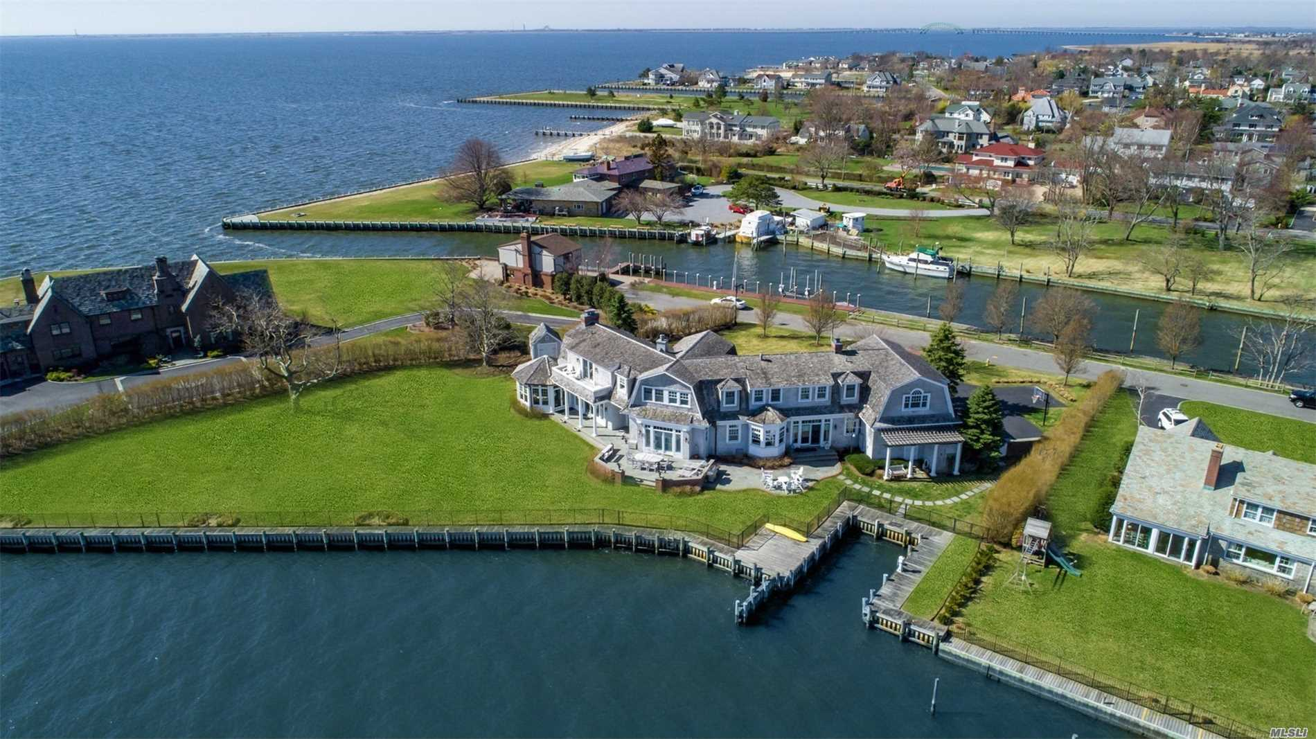 Spectacular 6800 Square Foot Dutch Colonial W/Cedar Roof,  3 Car Garage & Water Views From Every Room, Located In Private Community With approx 325 Feet Of navy Bulk-Heading (2001) 10 Foot Ceilings Grand Living Room With Wood Burning Fireplace & Dining Room Eik With Family Room With Gas Fireplace. Grab A Cocktail & Head To The Bar. Master Bedroom Suite With Gas Fireplace And Large Walk In Closets And Spectacular Master Bath.