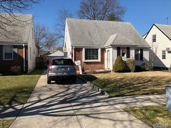 Wide Cape On Beautiful Block. Walk To City Bus And Bay Terrace Shopping Plaza! Original 3 Bedroom Converted To Two, (Easy To Convert Back). Hardwood Floors Under Carpet,  Sunny Eat In Extension Off Kitchen,  Detached 1.5 Car Garage With Plenty Of Parking In Driveway.