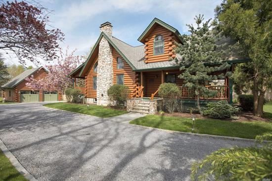 Stunning Chalet-Style Home, Impeccably Built And Maintained. Covered Porches Perfect For Outdoor Entertaining. Open Floor Plan, Kitchen/Dining + Living With Soaring Stone Fireplace At Center Stage. 3 Bedrooms, 2 Baths Perfectly Situated On Over 2 Acres Of Level Property. 2-Car Garage With Second Story, Perfect For Additional Storage.