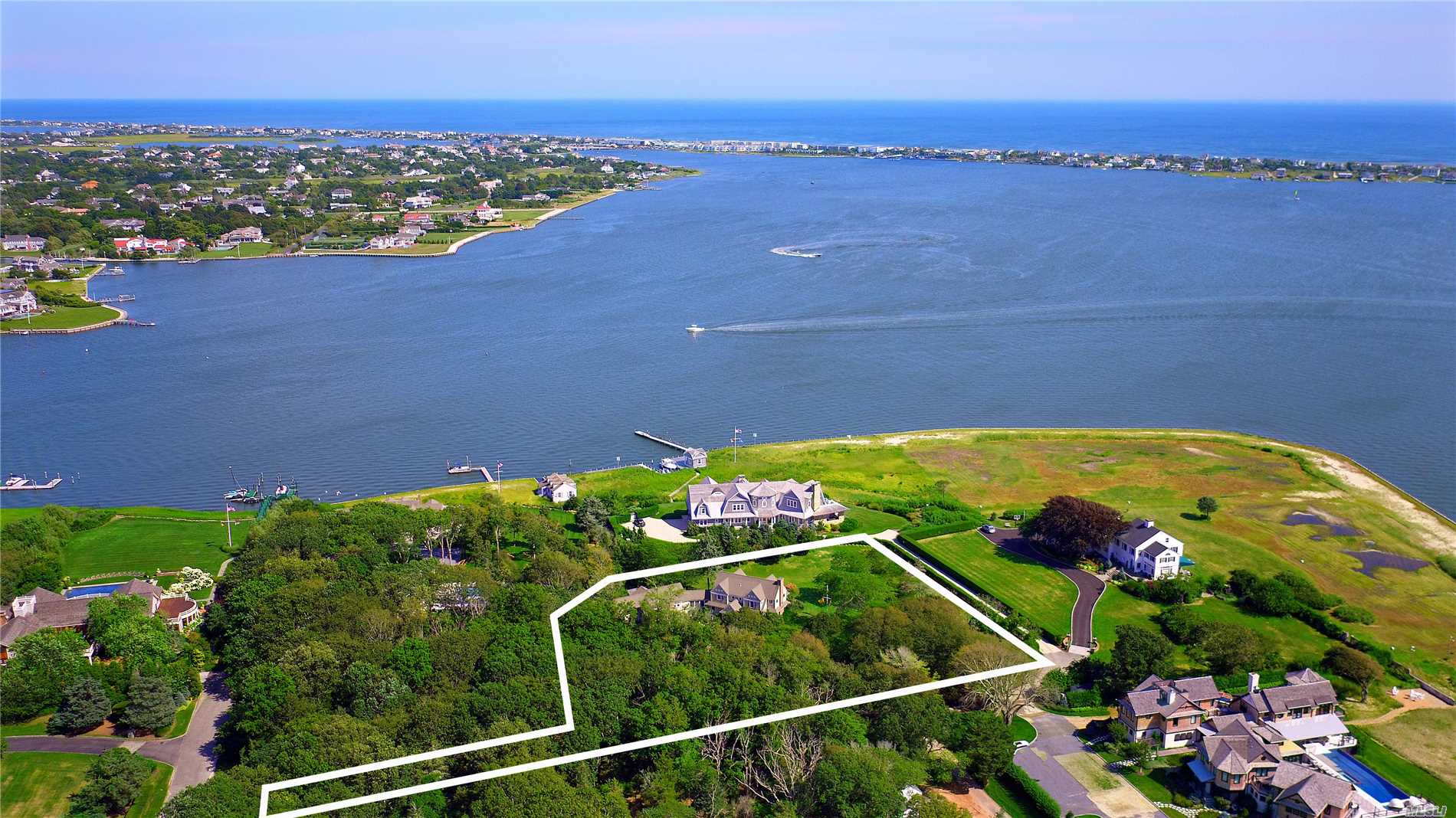Secluded Country Living W/ Stunning Bay Views. Set On 1.84+/- Acres, You'll Find 4000 Sf Home W/ Unimpeded Views Of Moriches Bay. 1st Floor Has Open Floor Plan W/ Kitchen, Dining & Family Room W/ Fireplace. 2nd Floor Boasts En-Suite Guest Bdrm & Large Master Suite W/ Fireplace, En-Suite Ba, & Balcony. Adjacent To Main House Is A Separate Guest Wing Offering 3 Bdrms, 2 Ba, Kitchen, Loft, & Living Rm W/ Fireplace. Outdoors You'll Find Expansive Decking, Rolling Lawns, & Breathtaking Water Views.