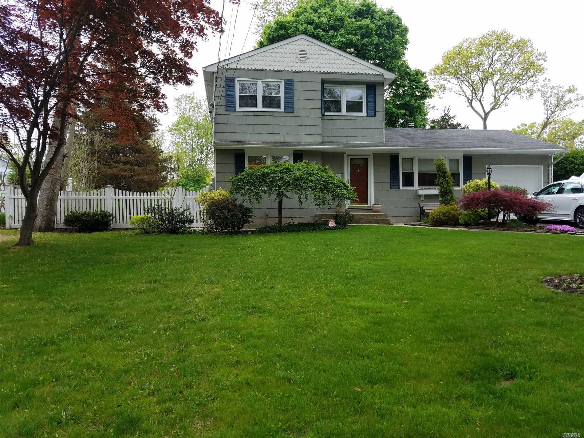 Beautiful Mint Condition Center Hall Colonial With Eat In Kitchen And Formal Dining Room. Gorgeous Den With Fireplace. Perfect For Entertaining. Sprinkler And Alarm System. Close To Transportation And Mall. Near Lake Grove Border. A Must See.