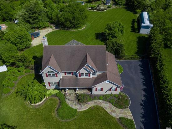 Magnificent Horse Property, East Moriches Schools, Adjacent To Preserve. This Property Has It All! Custom, Finest Quality Craftsmanship Throughout, Cathedral Foyer, Gourmet Kitchen W Wall Oven & Granite, Gas Heat And Fireplace, Double Crown Moldings And Wainscot, Enormous Master Suite W 2 Walk In Closets And One Double. Beautiful Expansive Private Park Like Grounds, Large Koi Pond, Gazebo, 2 Oversized Portable Barns, 3 Sheds, Stone Patio With Pergola And A Wind Turbine! Natural Gas Dryer & Bbq
