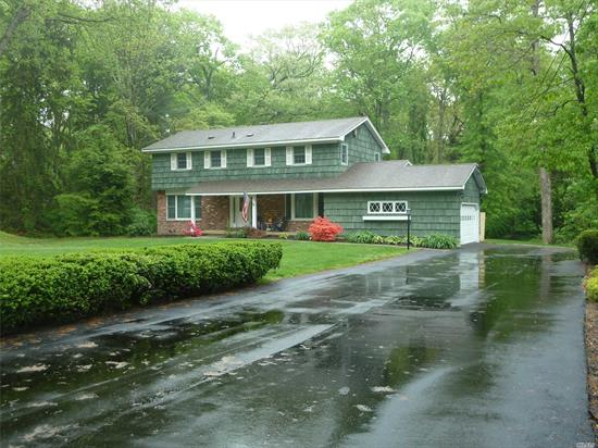 Come Listen To Nature At This Totally Updated Center Hall Colonial Set On A Flat Usable Acre In The Point Of Woods Area. Featuring Four Bedrooms, Two And A Half Baths. Master Spa Bathroom, Gourmet Kitchen, Central Vac, Cac,  Deck For Entertaining.