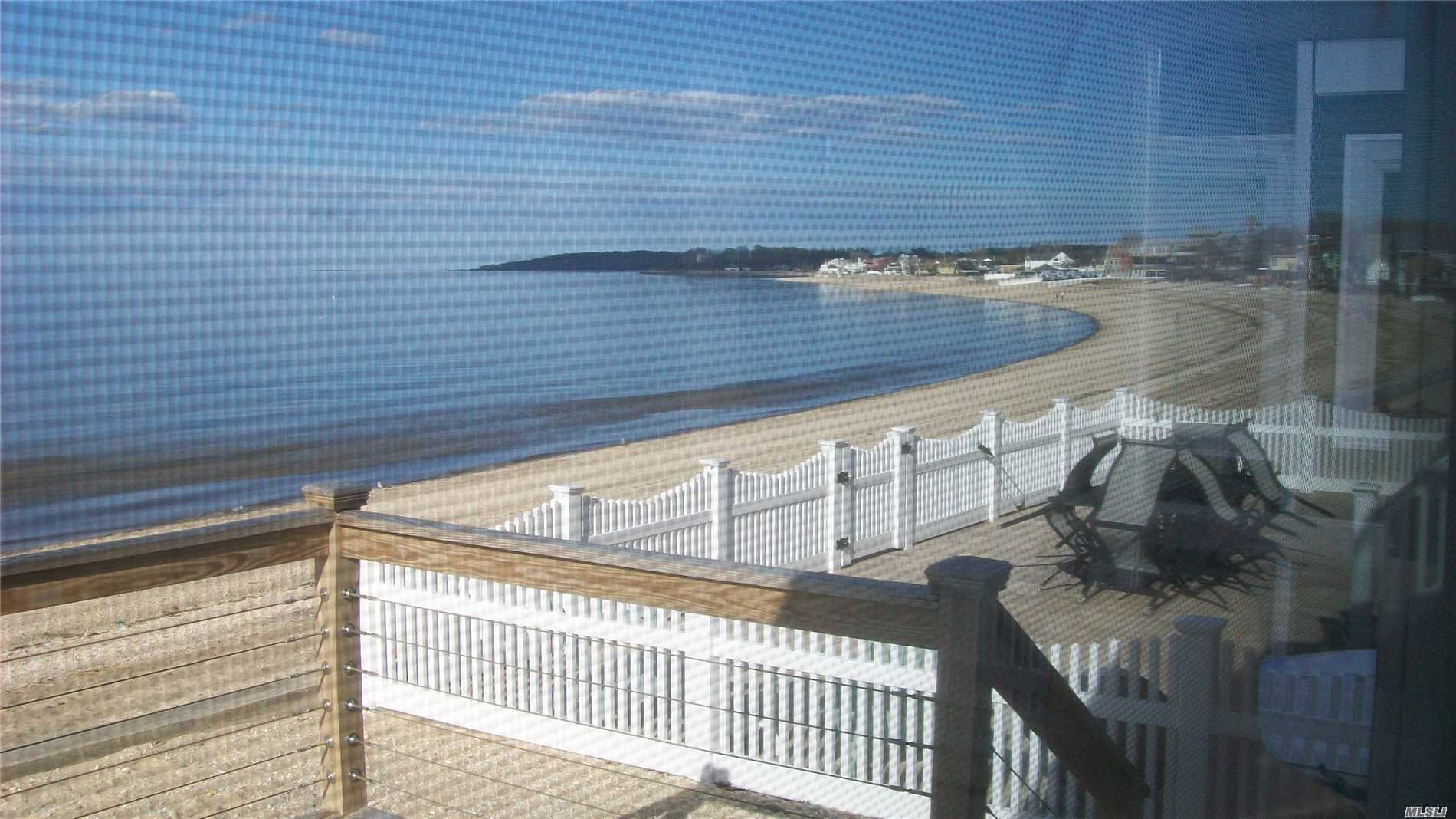 Beachfront Charmer. Open Floor Plan To Maximize Views!! Updated Kitchen. Living Room W/ Wood Burning Fireplace. Great Deck, 3 Brms, 1.5 Baths.