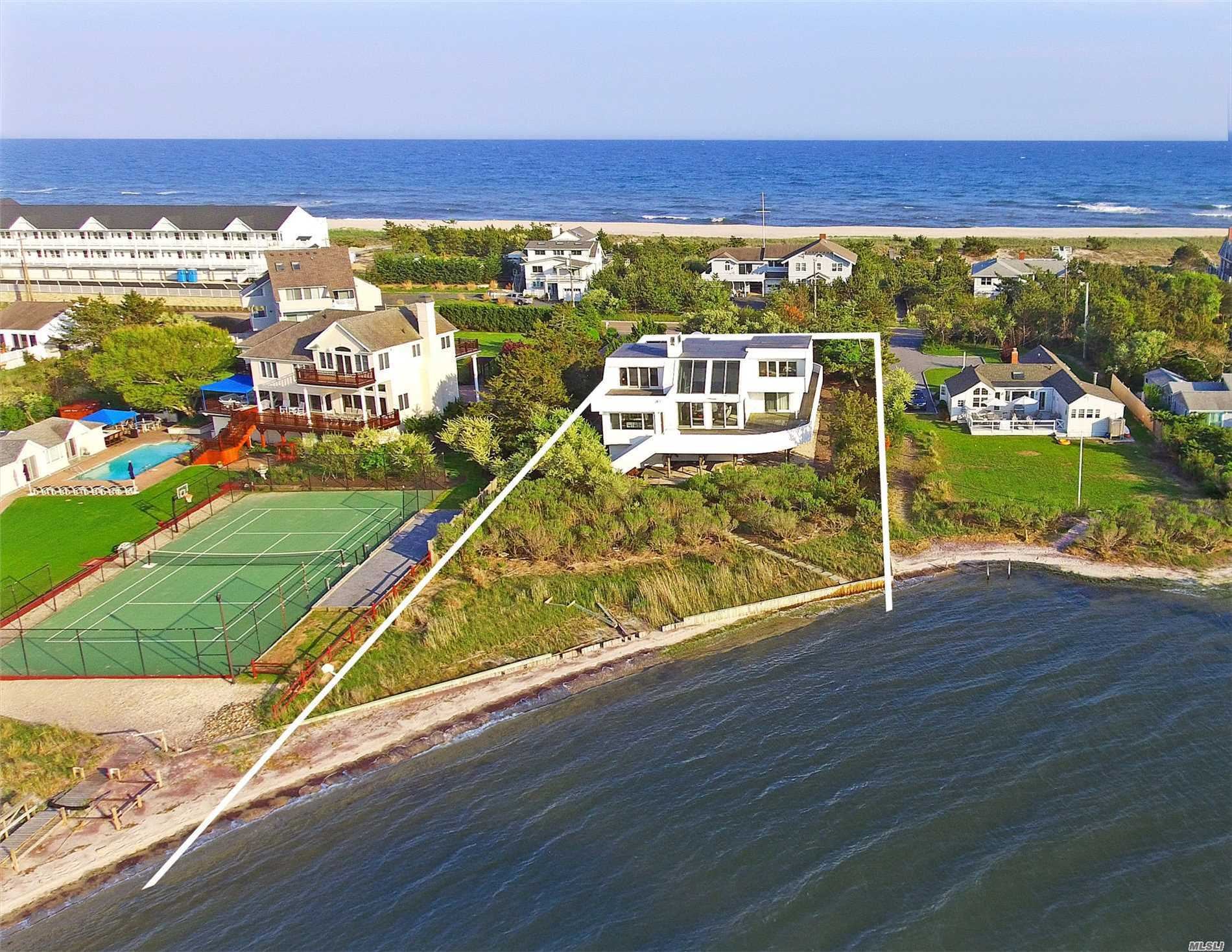 Bayfront W Pool & Ocean Access. Living Room W Wet Bar, Dining Room, Renovated Kitchen W Stainless Apl. 1st Flr 3 Guest Beds & 2 Baths. 2nd Level Junior Master W Marble Bath, Master Suite W Renovated Bath & Private Deck Overlooking The Pool. Both Suites Also Have Decks Overlooking The Bay. Deeded Row To Ocean, Bulkheading, 2 Car Garage, & Ample Decking.