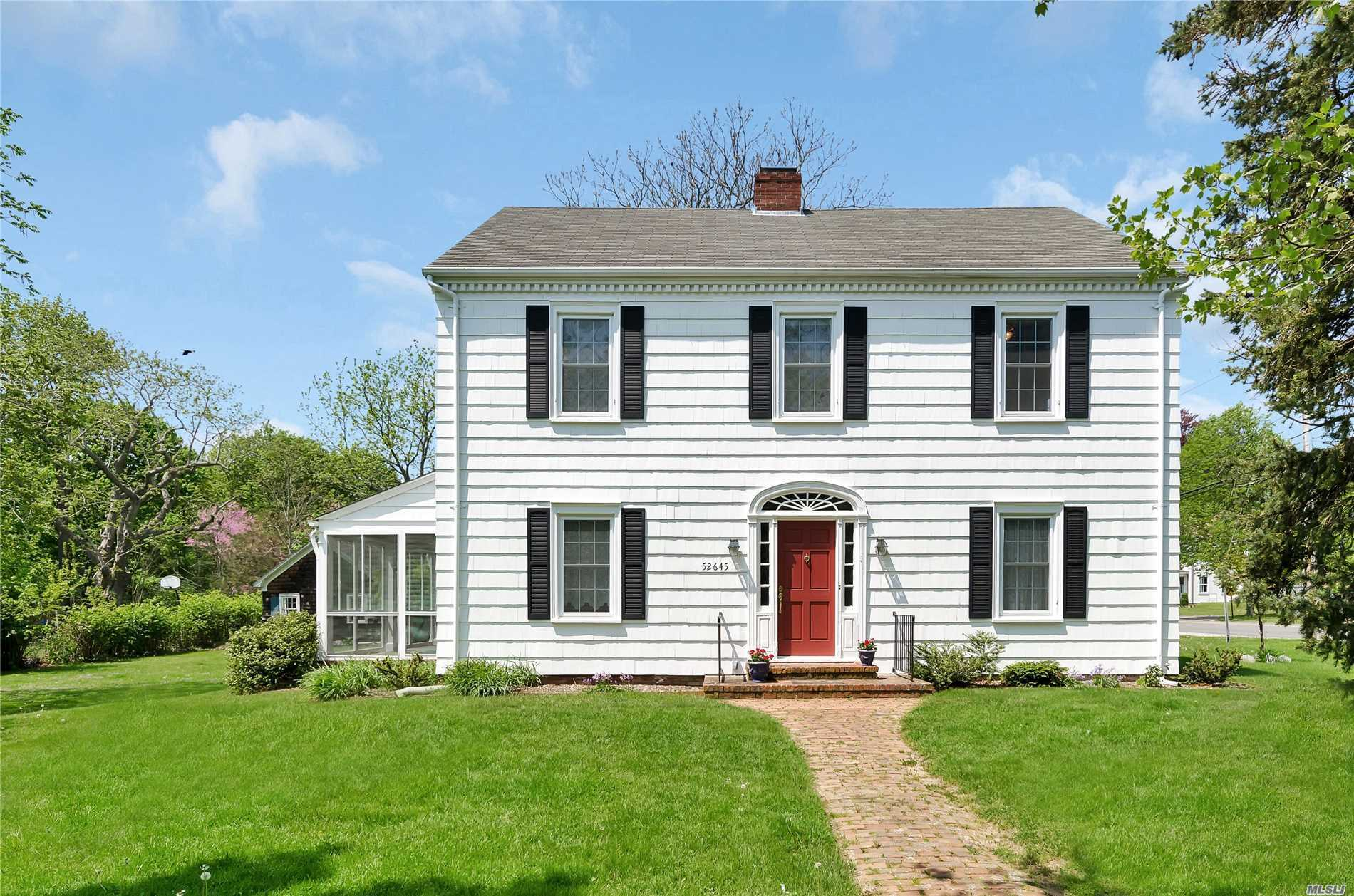 This Classic Center Hall Colonial Offers The Opportunity For Gracious Living With A Center Hall Winding Staircase, Lr W/Fpl, Fdr, Eik, Office/Br, 4 Bedrooms, Full Walk-Up Attic, Screened Porch.  Street Gas, Public Water. In Town Location - Walk To All. Zoned Residential Office. All On Approximately 1/2 Acre.