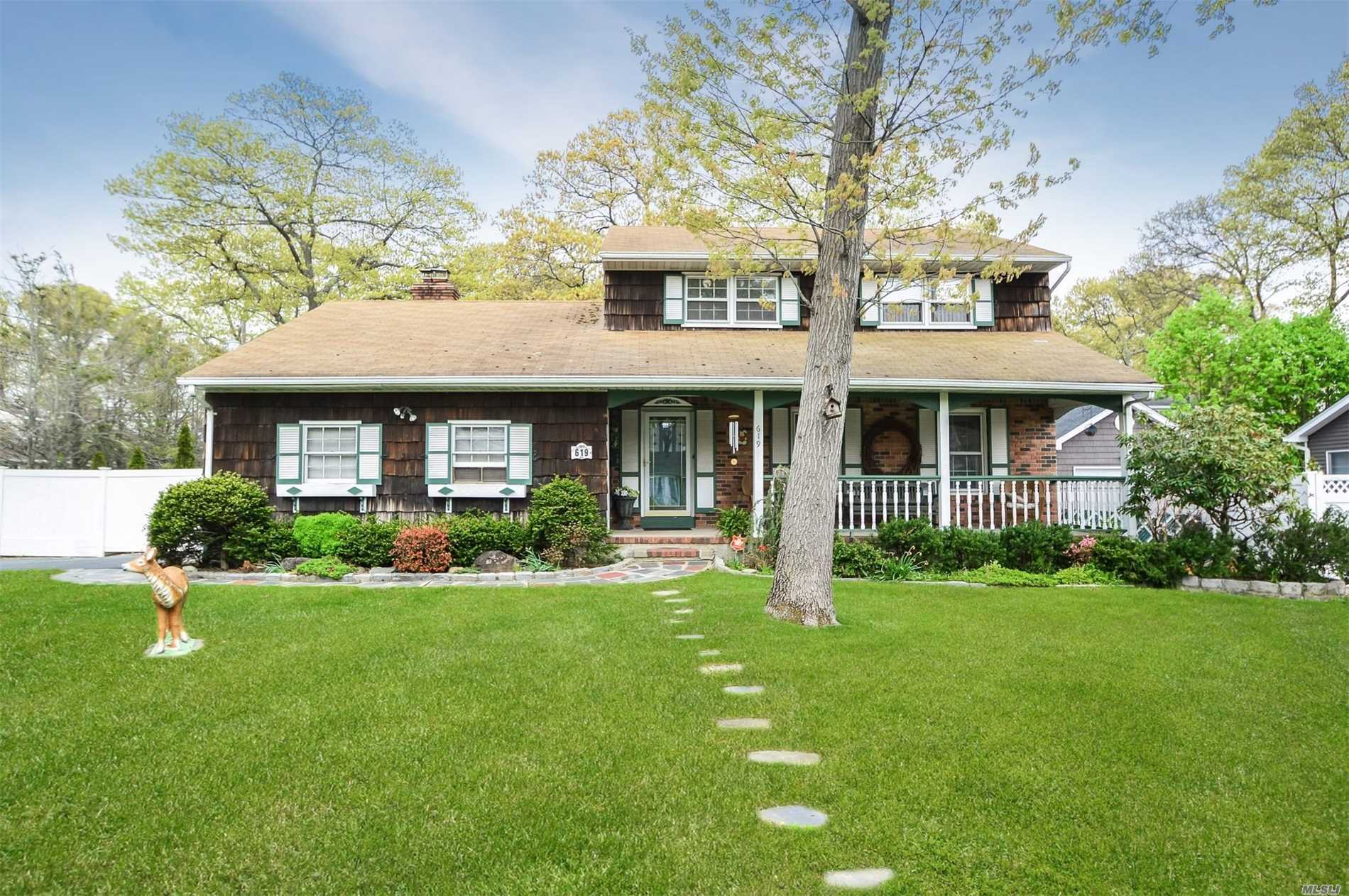 Beautiful True Center Hall Colonial Set On Large Park Like Grounds. Summer Time You Can Enjoy Entertaining On 2 Tier Deck And Relaxing On Your Front Porch. Winter You Can Snuggle Up In Front Of Your Fireplace.
