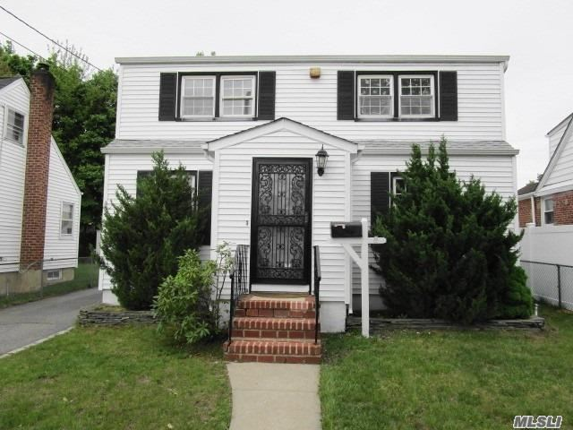 Great Value! This 4 Bedroom, 2 Bathrooms Colonial With Finished Basement, Rear Patio, Private Driveway And 1 Car Garage Is Priced Right. The Home Is Freshly Painted With Refinished Hardwood Floors, New Carpeting, Updated Boiler And Hot Water Tank. The Property Is Located Within Walking Distance To Malverne Train Station, Malverne High School, Middle School, And Hempstead Lake State Park. The Southern State Parkway Exit -17 Is Easily Accessible And Is Less Than A Five Minute Drive.