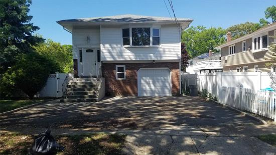 Renovated Hi Ranch With 8 Rooms 4 Bedrooms And 2 Baths. New Kitchen And Baths, Carpeting And Beautiful Hardwood Floors.Valley Stream Schools. Close To Shopping, Transportation And Major Roadways.
