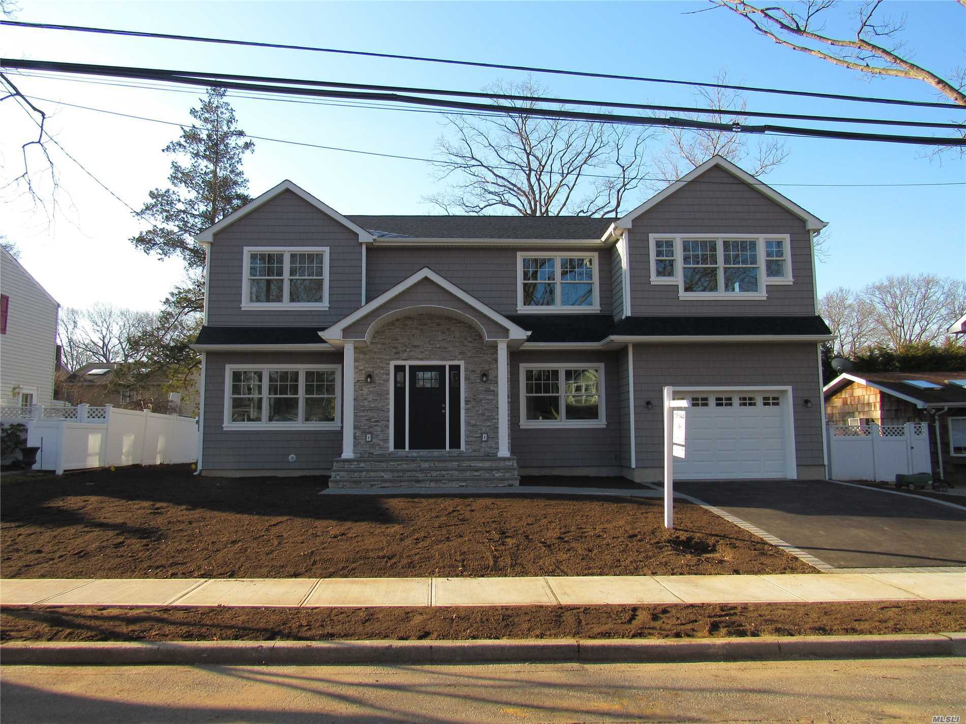 Prime Massapequa Woods Mid Block Location, New Construction Custom Colonial Features A Huge Backyard, Open Layout, Living Room With Gas Fireplace, Top Of The Line Custom Kitchen, Formal Dining Room, Master Suite Features Spa Bath with Oversized Soaking Tub & Walk In Rain Shower, Large Walk In Closet, Additional Double Custom Closet, 4 Additional Spacious Bedrooms All With Double Custom Closets, Large Full Bathroom, 2nd Floor Laundry Room, Attic Storage, 2 Zone Central Air, Anderson Windows