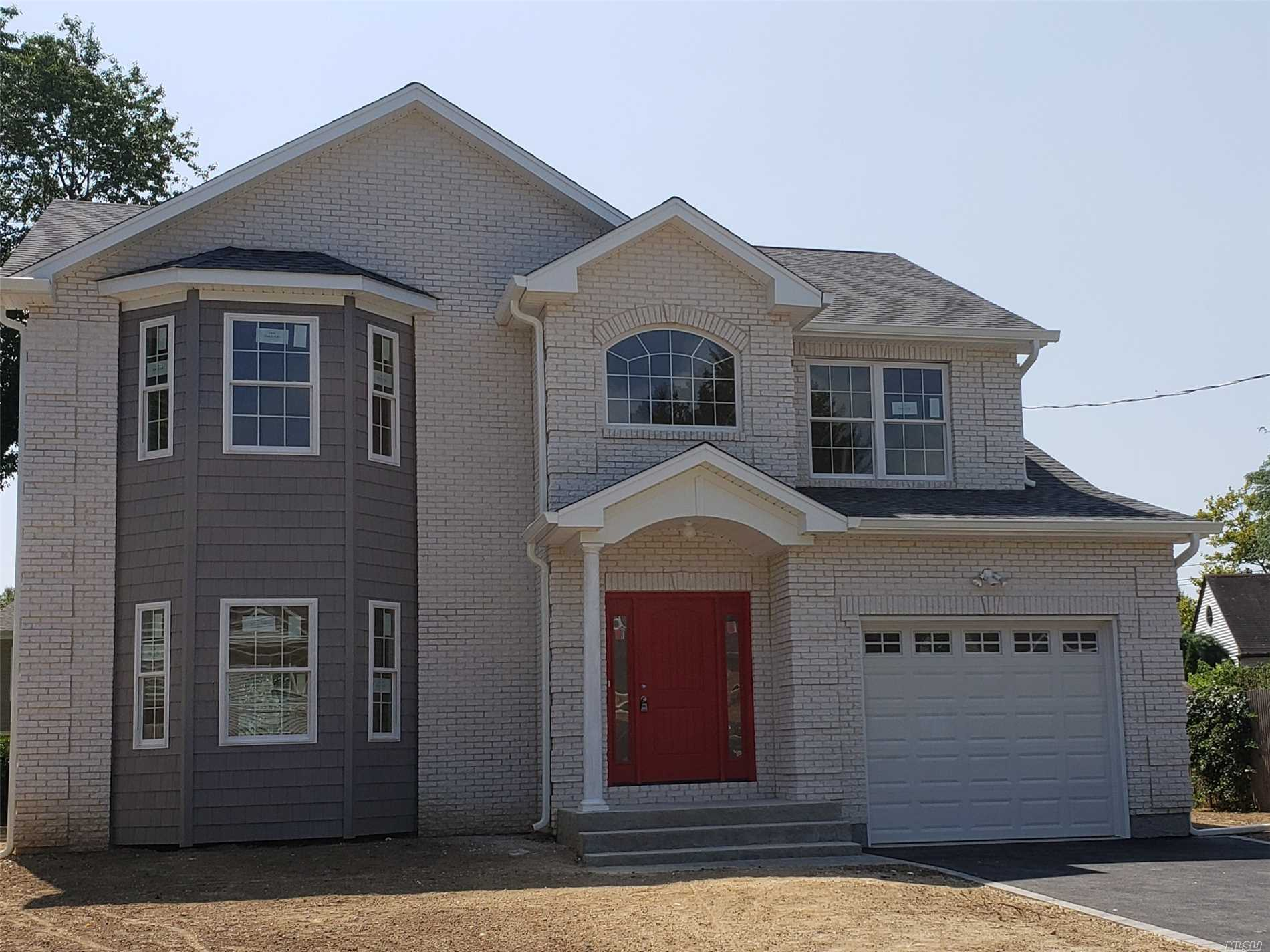 To Be Built !! Exceptional! 4Br, 2.5Bth, Colonial, Spacious Open Floor Plan, Gourmet Eik W/Stainless Appls, Hardwood Floors Throughout, Cac, 2nd Flr Laundry, Luxurious Master W/Ensuite, Dual Walk In Closets, Custom Millwork, 8 Ft Ceiling Basement W/ Ose. Photo Not Exact.
