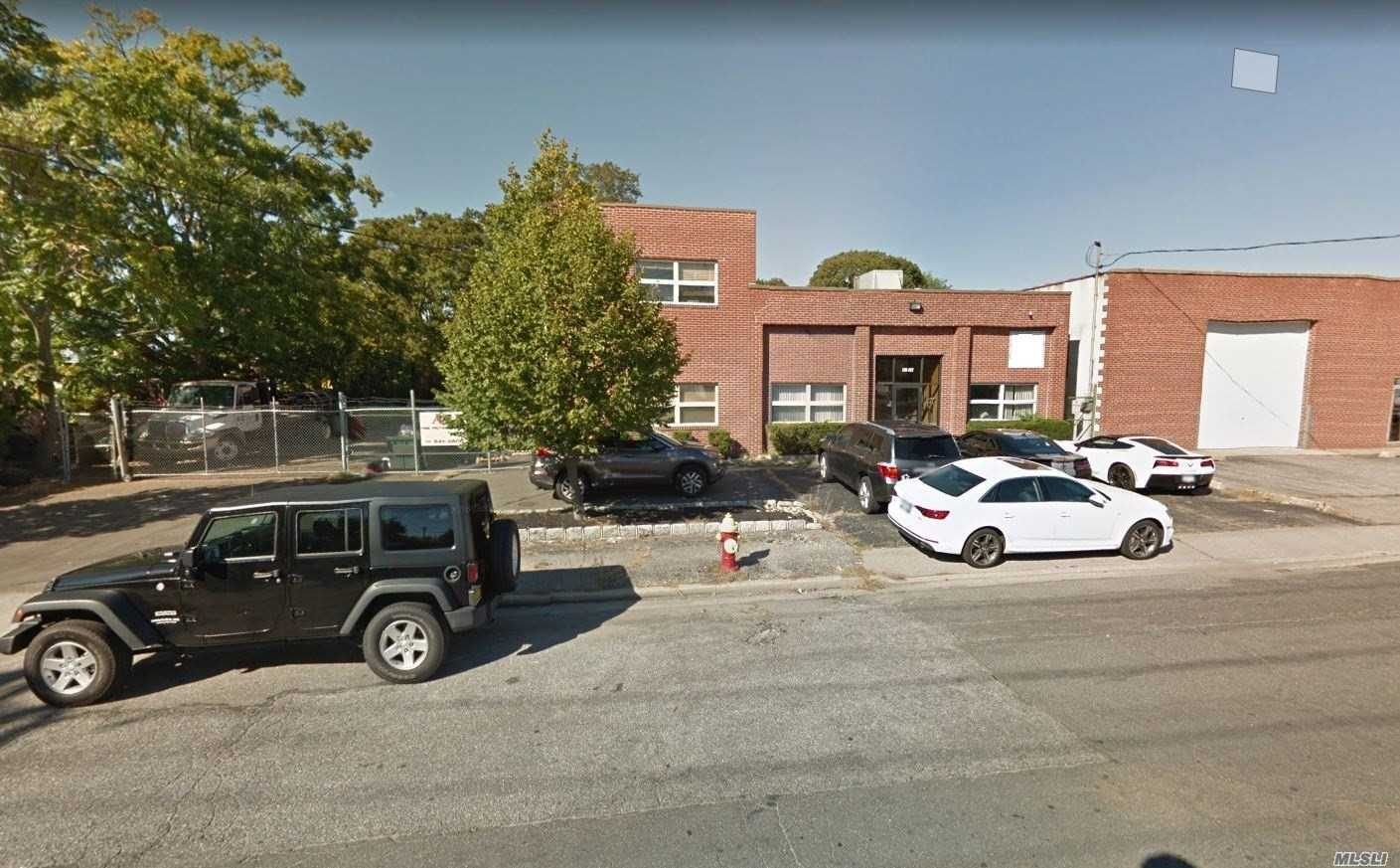 Unique Opportunity To Rent A 2 Story Huge 8, 000 Sq. Ft. Brick Office Bldg In Prime Area With Additional Yard (50 X 188). Currently Has 6 Offices, Conference Room, Kitchen & 3 Bths, 2 Bays 15 Ft. High With Roll Ups And Potential To Have 3 More. Basement And Attic Storage. Updated Heating System. Interior Fire Sprinkler System. 6 Parking Spots Alongside 50 X 188 Yard For Additional Parking. Triple Net Lease.