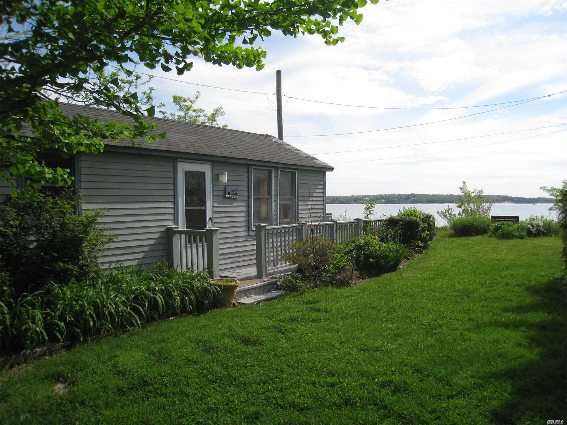 Charming Beachfront Cottage In The Bayfront Hamlet Of New Suffolk. Enjoy The Simplicity Of Summer: The Views, The Deck And Garden, And Your Sandy Bay Beach. This One-Bedroom Full Season Rental Is Easy On The Budget Too; Utilities Included.