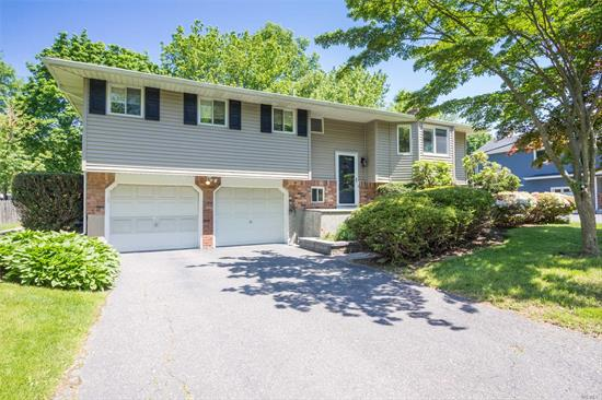 Newly Updated Home In Famed Harborfields School District. New Master Bath, Newer Windows, New Roof, Updated Kitchen W/Granite Counter-Tops & Stainless Appliances. Solid Wood Interior Doors, Craftsman Style Hand Cut Moldings, New Washer/Dryer. Room For Pool. Minutes To Lirr, Parkways , Schools, Shopping. Legal Accessory Apartment.