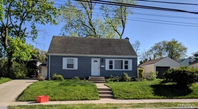 Centrally Located Four Bedroom Cape Style Home With A Full Basement & Detached Garage. Nice, Neat Curb Appeal. Excellent Opportunity For A Handyman Or First Time Buyer To Renovate!