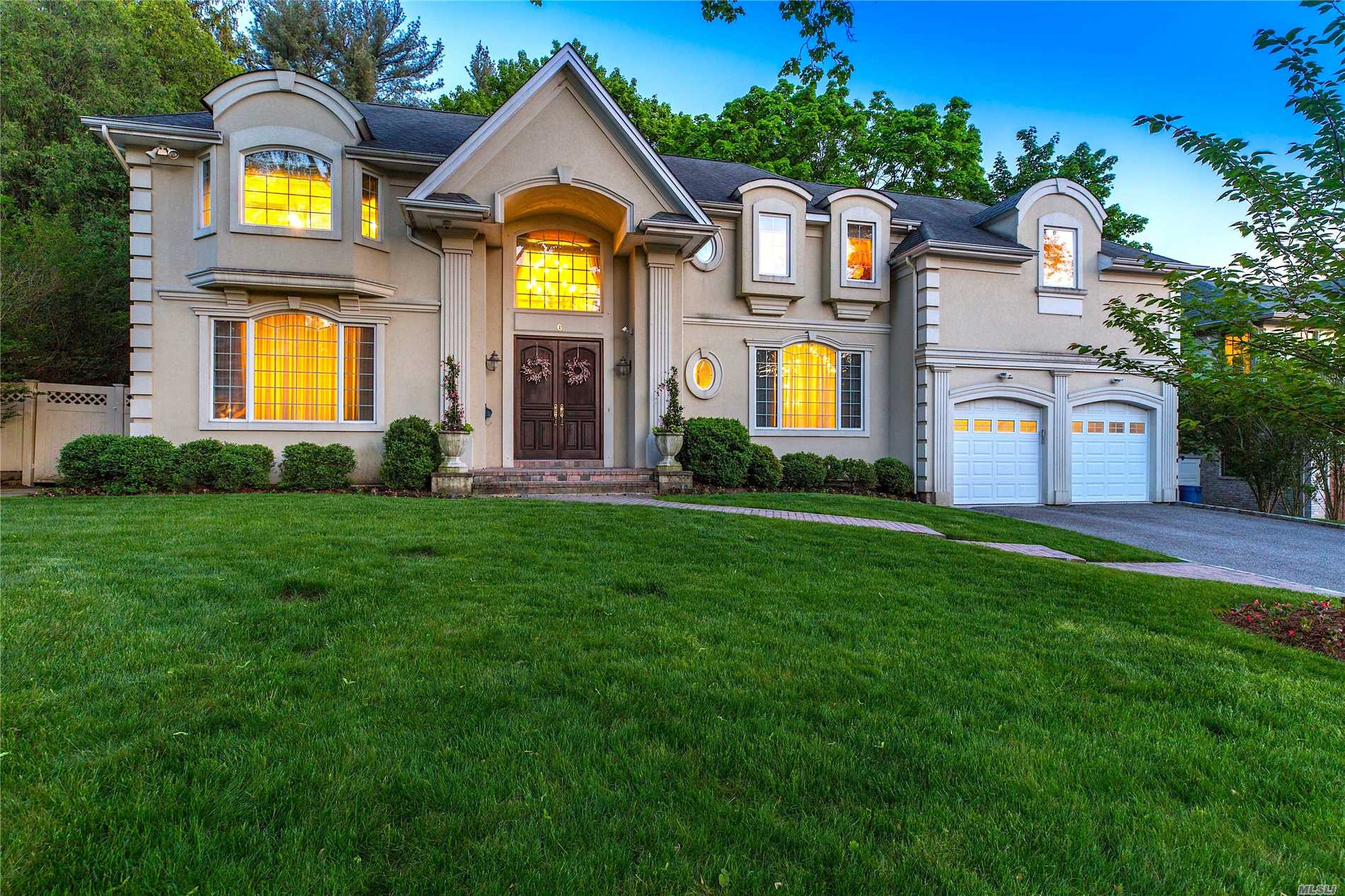 Stunning Center Hall Colonial Situated On Beautiful Flat Property In The Prestigious Flower Hill Section Of Roslyn. The Home Boasts Soaring Ceilings, Chef's Kitchen With Top-Of-The-Line Appliances, Large Living Room, Den And Dining Room With Custom Moldings And Finishes. 5 Bedrooms Plus Bonus Upstairs Family Room. Full Basement. Flat Private Backyard. Port Washington Train Sticker And Roslyn Schools.