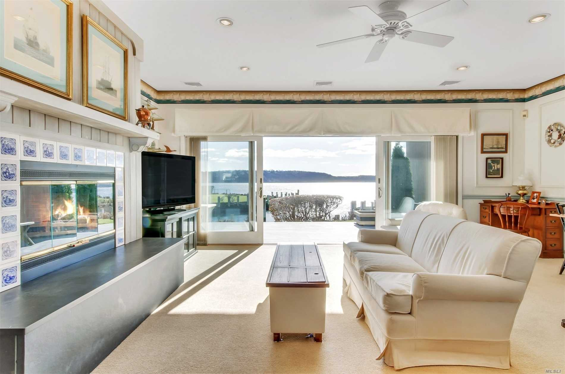 Upscale Bayfront Townhouse Condominium With World Class Views Of Peconic Bay And Shelter Island From Common Living Areas And 2nd Floor Master Suite. 40 Ft Deepwater Dock, 10Ft Depth At Mlt With Direct Bay Access. Close To Sandy Bay Beach, Park, And Greenport Village. Carefree Waterfront Living With Low Maintenance Of $650 And Taxes $4, 281.16.