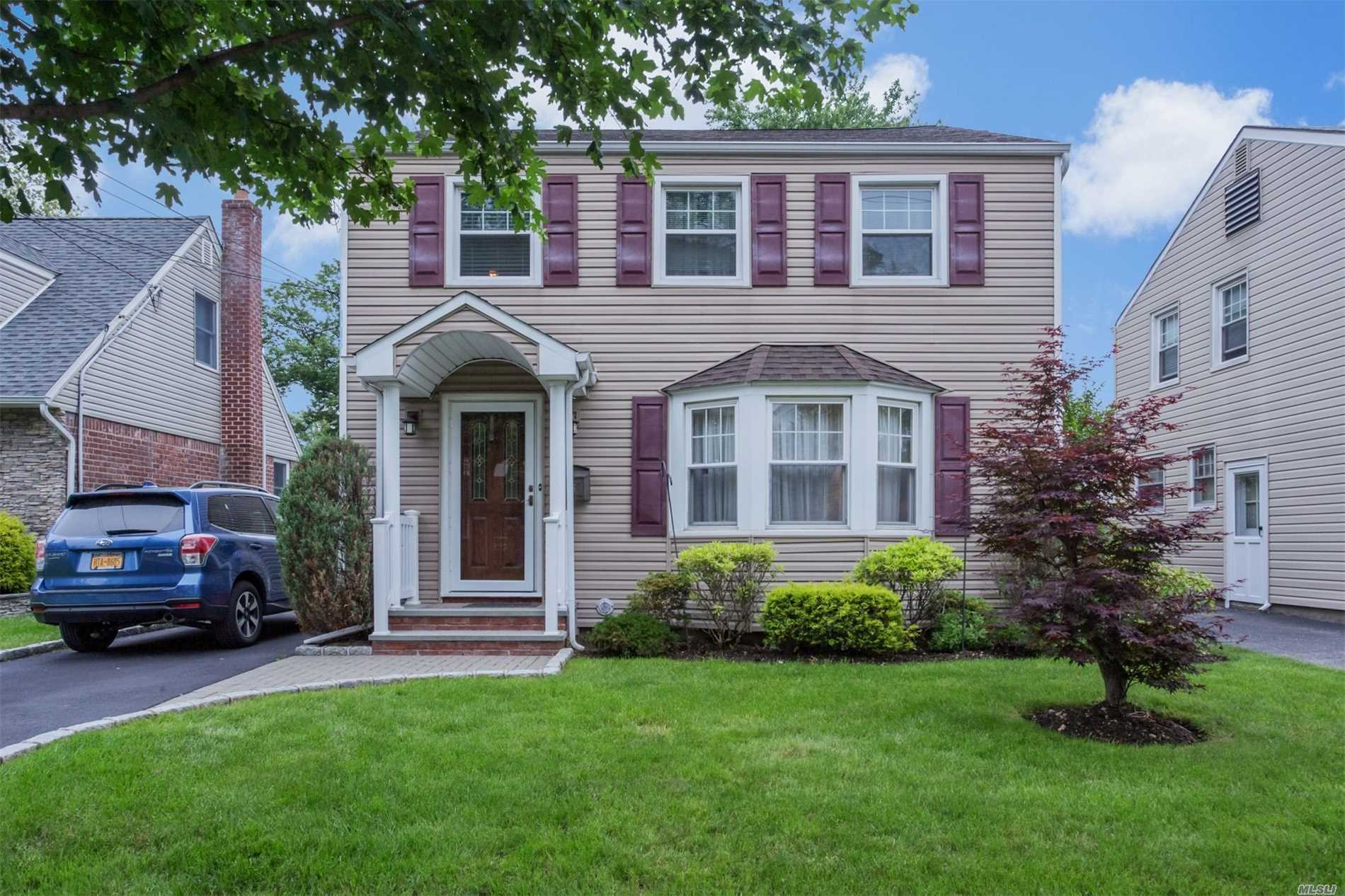 Outstanding Mid-Block Colonial, All Updated Stainless Steel Appliances, Granite Counters, Cherry Cabinets, Near Railroad, Park & Schools. A Must See!