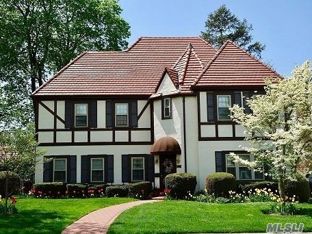 Exquisite French Tudor In Desirable Estates Location. 1st Fl Has Lge Fdr, Spacious Lr W/Gas Fp, Den, Updated Kit & Powder Rm. 2nd Fl Has King Sized Master Ste, Full Size Ba & 2 Add'l Lge Br's Great Closets & Hall Ba. 3rd Fl 2 Add'l Lge Br's, Great Closets & Storage. Amenities Incl Ig Sprinklers, Gas Heat, Hw Floors & Low Taxes On Oversized 60X125 Lot! Close To Great Schools, Lirr, Parks, Shopping, Etc. This Is Truly A Must See!!