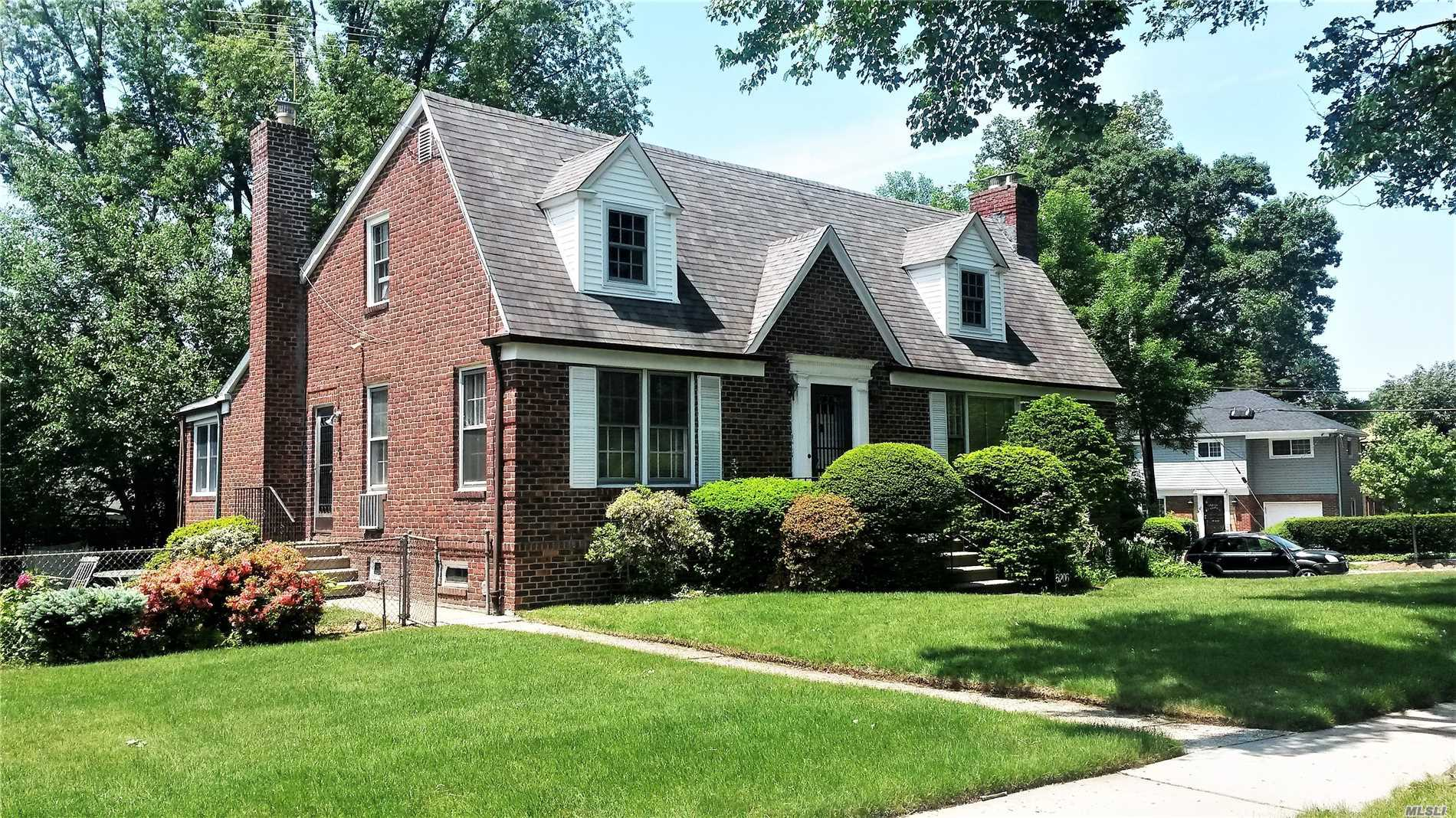 This House In Douglaston Sits On A 112' X 105' Irreg Corner Property. Solid Brick Home, Perfect For Large Family, Spacious Rooms, Lots Of Windows And Closet Space. Two Fireplaces,  Hardwood Floors, Large Bedroom On First Floor, Three Large Bedrooms On 2nd Floor, Eat-In Kitchen, Sunken Lr, Formal Dr, Den, Large Finished Basement, 2 Full And 2 Half Baths, True Center Hall Entryway, Inground Sprinkler System, Beautiful Private Yard. Near Expressways, Shopping Centers And Lirr. District #26 Schools.