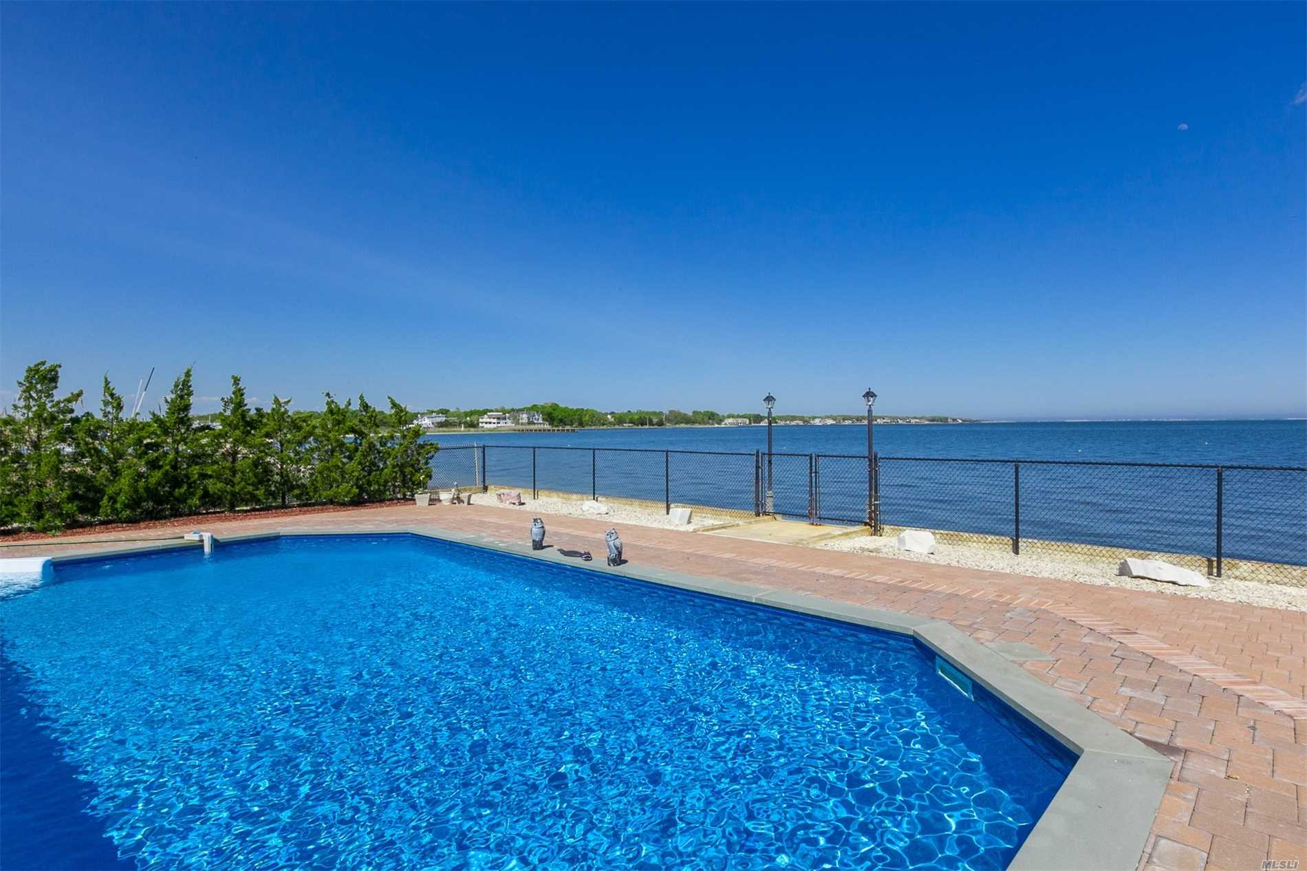 Incredible Bayfront Home With Amazing Waterviews Features: Great Room With Floor To Ceiling Windows & Fireplace, Eik W/Granite Counter Tops, Formal Liv Rm/Game Room, Master Bedroom Suite W/Walk In Closet, Full Bathroom And Terrace, 3 Additional Bedrooms, 1 Car Garage. Updated Central Air Conditioning & Heating System, In Ground Pool W/Pavers, Stunning Views Of The Bay. You Don't Want To Miss This One!!!