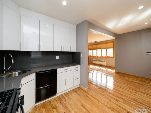 Bright & Sunny Fully Renovated High Ranch, Brand New Custom Kitchen W/Ss, Master Suitew/Bath And Backyard Access , 2 Additional Bedrooms , Full Bath, New Basement, Gleaming Hardwood Floors, Cac & Split Unit, Zoned For Ps 188, Close To Public Transportation , Express Bus To Nyc.