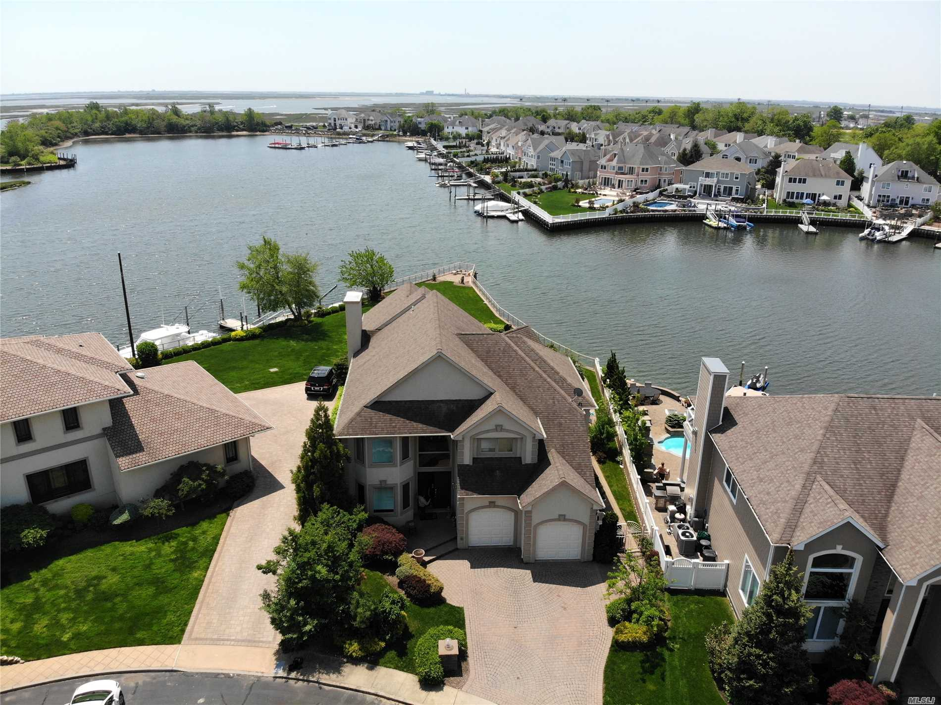 180' Of Bulkhead, Scenic  Seller Offering $10, 000 First Year Tax Credit. Taxes Have Been Grieved. Letter On File Approx 25% Reduction. Amazing Waterfront W 3 Master-Sized Bedrooms, All W Their Own Baths, Granite & Stainless In Kitchen, Hw And Ceramic Tiles On Floors. Entertainment Yard W Ig Pool, Bulkhead Suitable For Large Boats, Seconds To The Open Bay! The Location & Condition Of This House Make It A Must See!