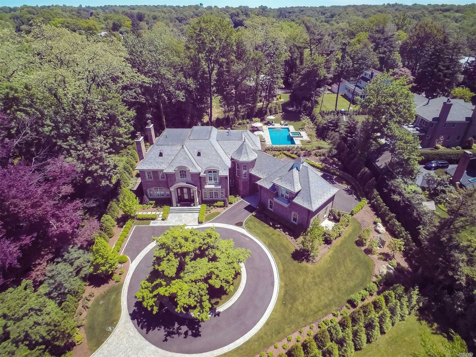 Exquisite French Normandy Custom Built Home Completed In 2017. 6100 Sq. Ft Of Pure Luxury And Tranquility On .8 Acres With Gunite Salt Water Pool & Waterfall Spa. Landscape Design By The Laurel Group Features Year Round Flowering Specimen Plantings, Outdoor Kitchen With Built In Bbq And Rotisserie, And Gas Fire Pit. Three Car Heated Garage And Circular Driveway. 60Kw Whole House Generator. Sonos Sound And Lutron Programmable Lighting Throughout Entire House**Taxes Do Not Reflect New Construction