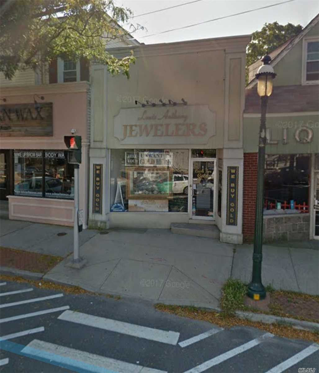 Storefront In Prime Islip Location! High Foot Traffic.. Large Parking Lot In Rear!