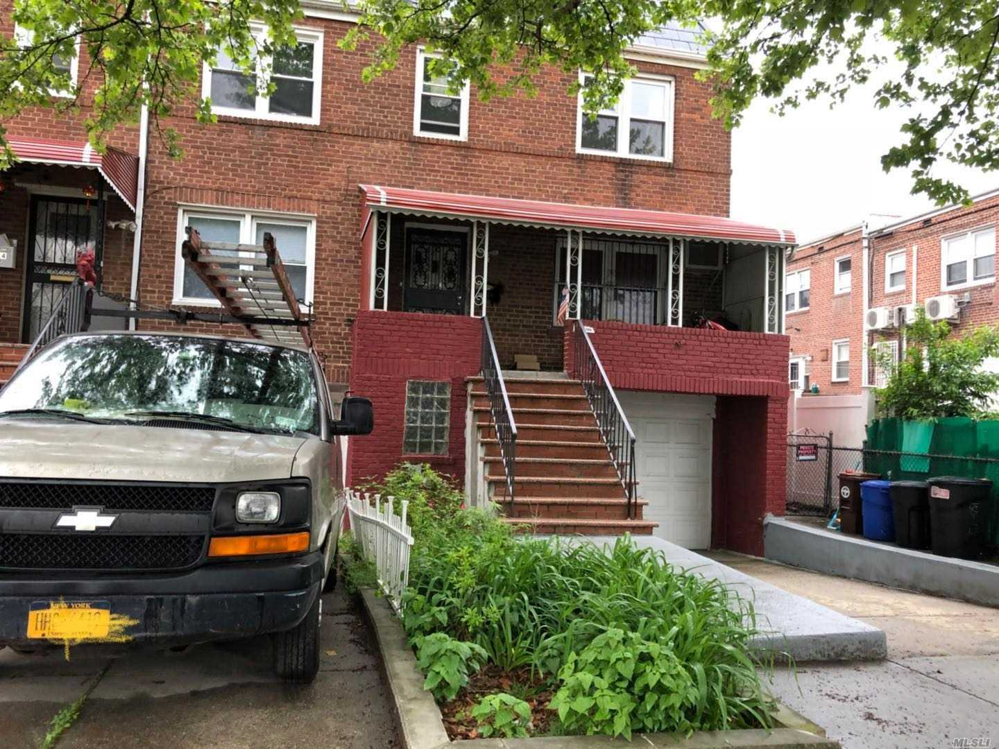 Great Location. 2 Family Corner Townhouse. Window In Every Room, Bright Exposure. 8 Minutes To Supermarkets. Garage And Private Driveway. Good Rental Income. Won't Last.