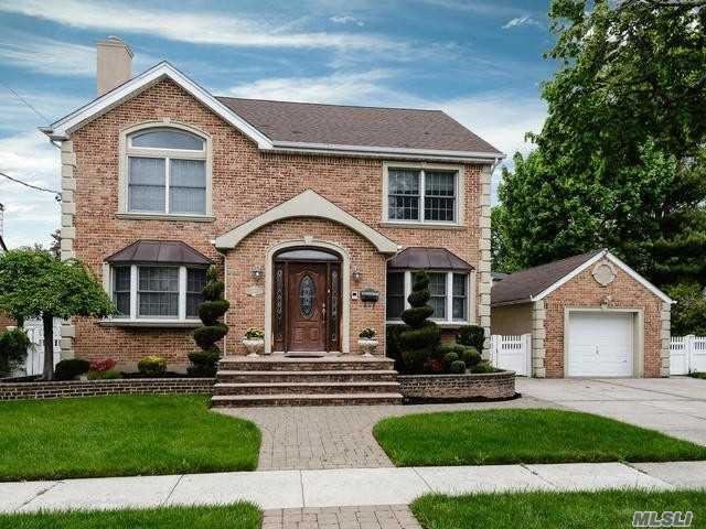Rebuilt In 2004 Brick/Stucco Colonial In The Park Circle Section Of New Hyde Park. Custom Built With Hardwood Floors Throughtout, Large Gourmet Eat In Kitchen, 5 Bedrooms 3 Full Baths. Large Master Bedroom Suite With High Ceilings.This Home Has Many Amenities Such As Radiant Heat In Tiled Areas, Driveway And Front Walkway And Steps. Central Vaccuum, Cac , Igs, Etc. Conveniently Located To Transportation, Shopping And Hospitals. Herricks School District.