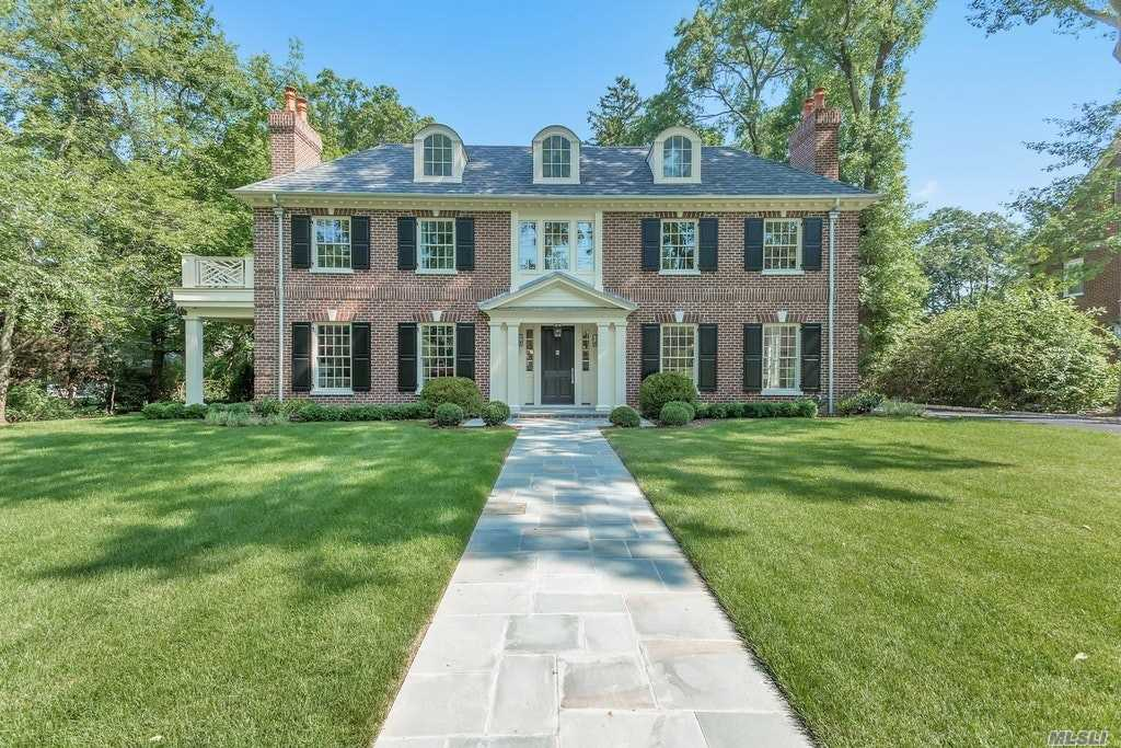 Stunning & Grand Newly Constructed 6 Bedroom Brick Center Hall Colonial Set On One Of The Prettiest Tree Lined Streets In Manhasset. 5200 Sq Ft Of Luxury On Approx Half An Acre Of Beautiful Lush Property. Bespoke Woodwork And Cabinetry With Incredible Attention To Detail With Select Custom Finishes Through Out. Gourmet Custom Eat In Kitchen Blending Traditional Design & Luxurious Modern Living, Stylish Entertaining Spaces & A Master Suite Oasis With Spacious Mahogany Deck Overlooking Property.