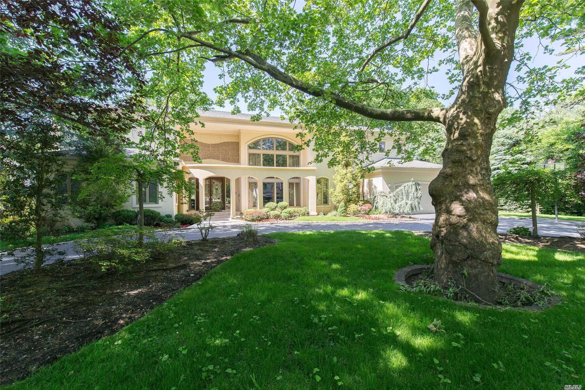Magestic Custom Built Contemp W/Soaring Double Height Entry, Floor To Ceiling Windows Welcome You To This Dramatic Sunlit Home. The Open Floor Plan Features Large Lr, Dr + Family Rm, State-Of-The Art Kit Opens Onto A Stone Veranda Overlooking 1/2+ Acre Of Lush Manicured Gardens. This Home Boasts A Heavenly Master Suite + Bth And 7 Add. Family Bdrms, 4.55 Baths.A Walk Out Bsmnt, Radiant Heat Thru Out. All In The Village Of Lake Success W/Private Police, Golf, Pool And Tennis.