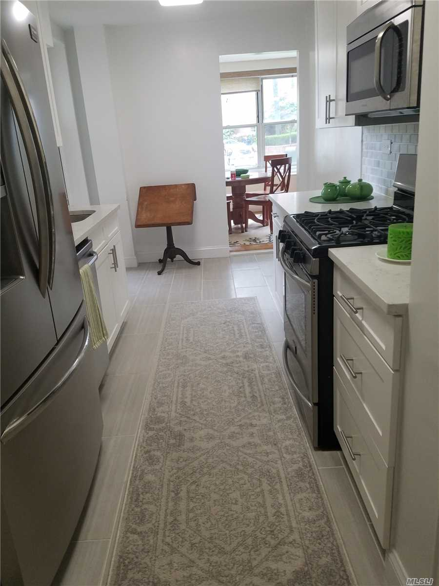 950 Sq.Ft. One Bedroom/ Renovated Throughout. Steel Appliances, Central Air/Heat, Reserved Parking Included, No Flip Tax/100% Equity......Washer/Dryer Permitted In Unit.....Close To All Transportation, Bay Terrace Shopping Center, Local Buses, Express Bus To City Right Outside Your Door/ Short Distance To The Lirr. A Must See!