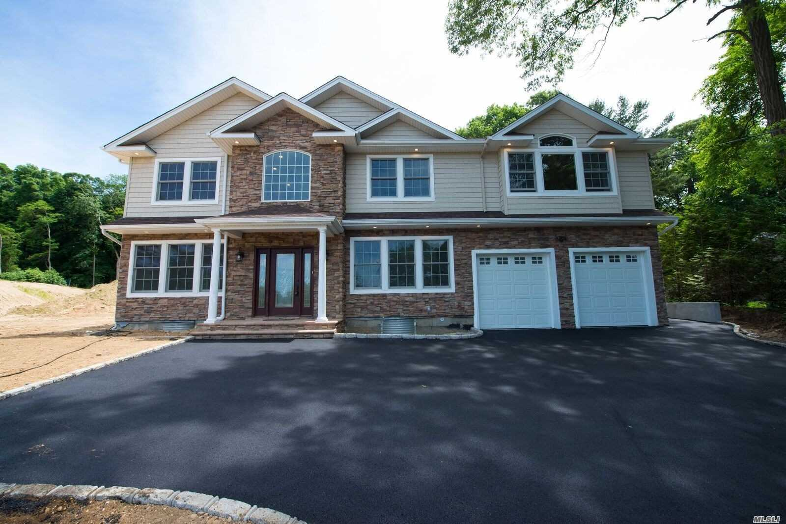Beautiful New Construction Home Built On Shy Of Half An Acre. Wood Floors, Granite And Marble Counter Tops, Ss Appliances, Ceramic Floors, Led Hi Hats. Constructed On A Hill. Very, Very Impressive. Way Too Much To List! Go Show And Sell! Blue Ribbon Village Elementary School. Minutes From The Lirr.