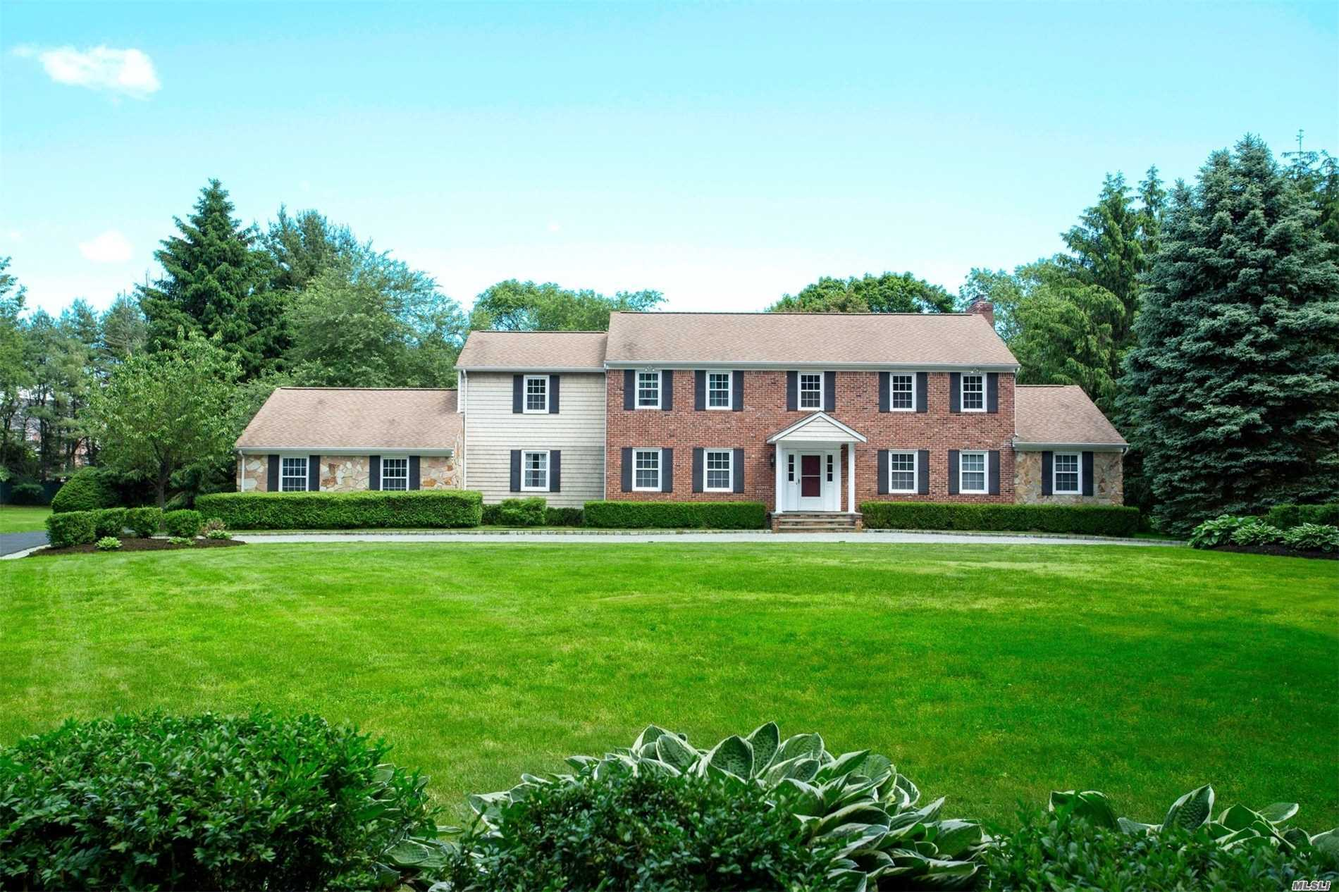 Price Adjustment! Breathtaking Views Of Gently Swaying Lawns Embrace This Gracious Center Hall Colonial That Is Classically Styled, With Delectable Country Accents, Updated Kitchen And Baths, And Sun Drenched And Gracious Rooms Throughout.Located Perfectly, It Is Minutes From Schools, Colleges, World Class Shopping, Golf, Beaches And Major Highways.