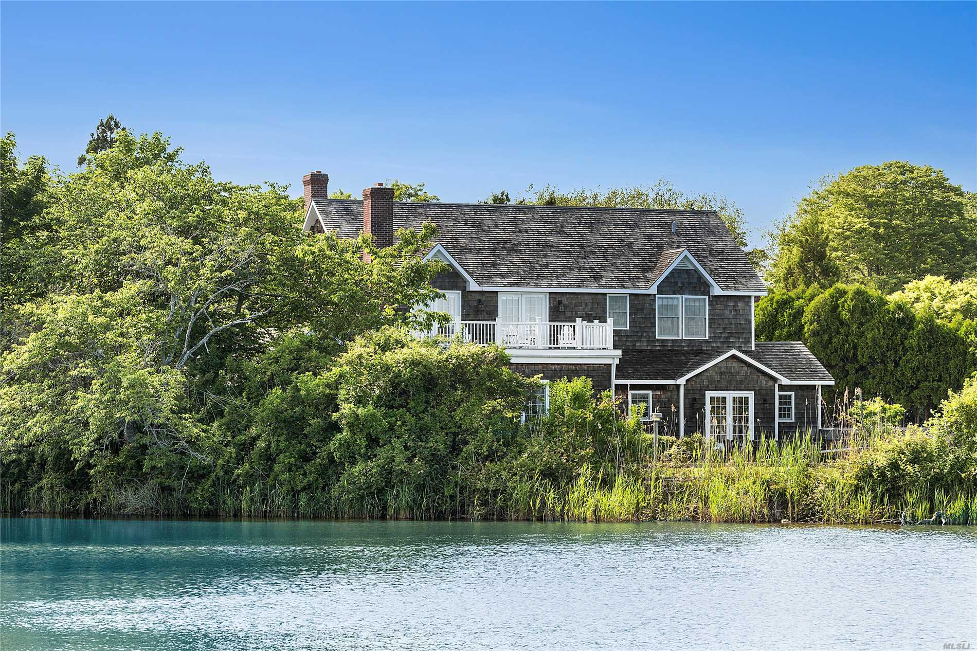 This Traditional Two-Story House In East Hampton South Is Located On Hook Pond And Is Next To Main Beach, With Direct Access To Hook Pond For Kayak And Paddle Board Enthusiasts. Completed In 2009, The First Floor Features A Living Room With Fireplace, Dining Room With Fireplace, Den, Master Bedroom And Bath, Large Country Kitchen, Powder Room, Laundry Room And Wide Plank Floors. The Second Floor Includes Three En-Suite Bedrooms And A Second Story Sundeck.