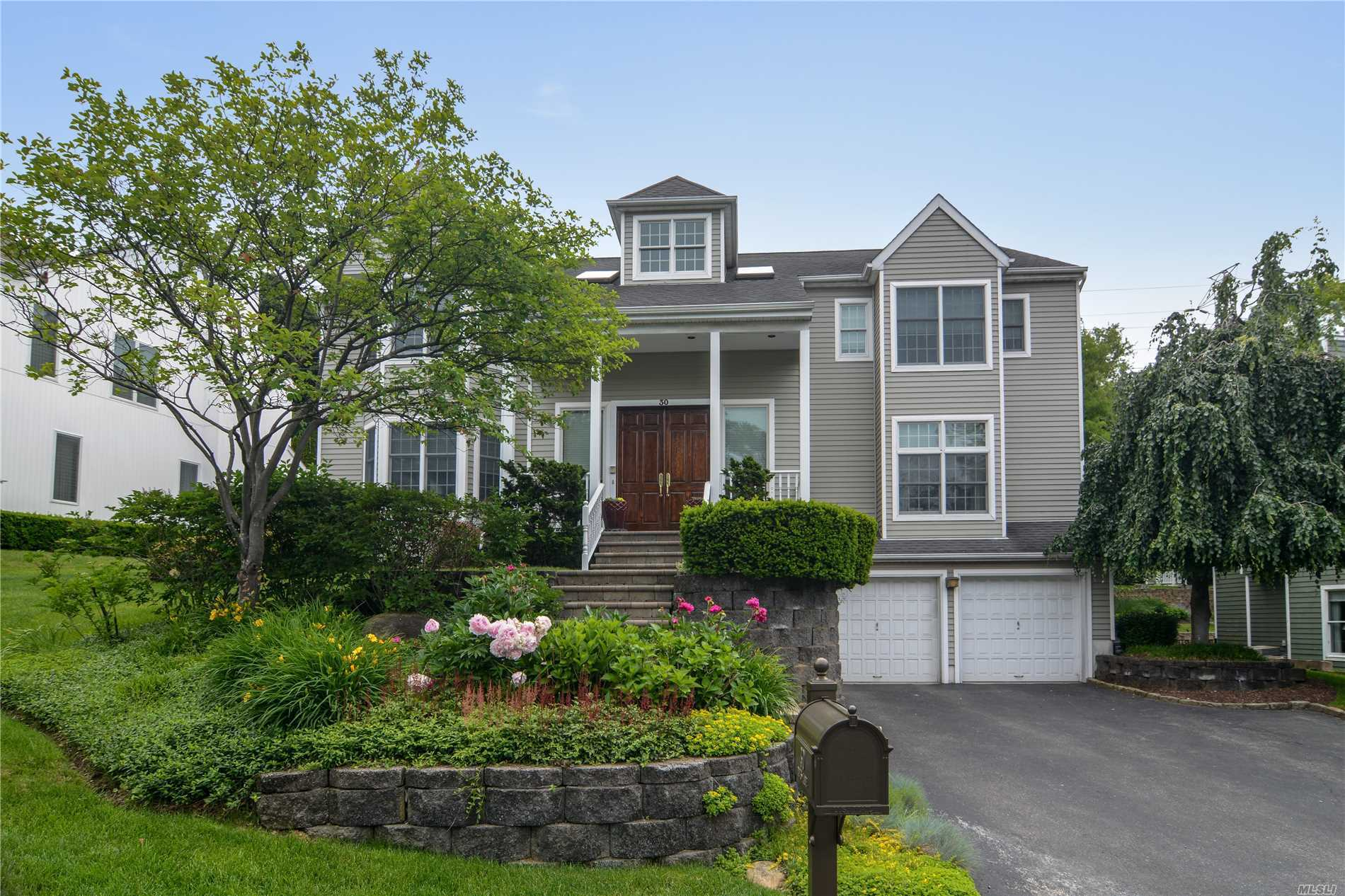 Roslyn. The One You Have Been Waiting For! Move Right In To This Renovated And Exceptional Home On A Beautiful Tree Lined Street Featuring A 2-Story Entry, Soaring Ceilings Throughout, All Large Formal Rooms For Entertaining, State Of The Art Designer Kitchen, Lavish Baths, Formal Living Room With Gas Fireplace, Hardwood Floors, Finished Basement, Spectacular Gated Backyard With Kitchen/Waterfall/Hot Tub. New Heat, Ac, Electric, Hot Water Heater. Truly Special!