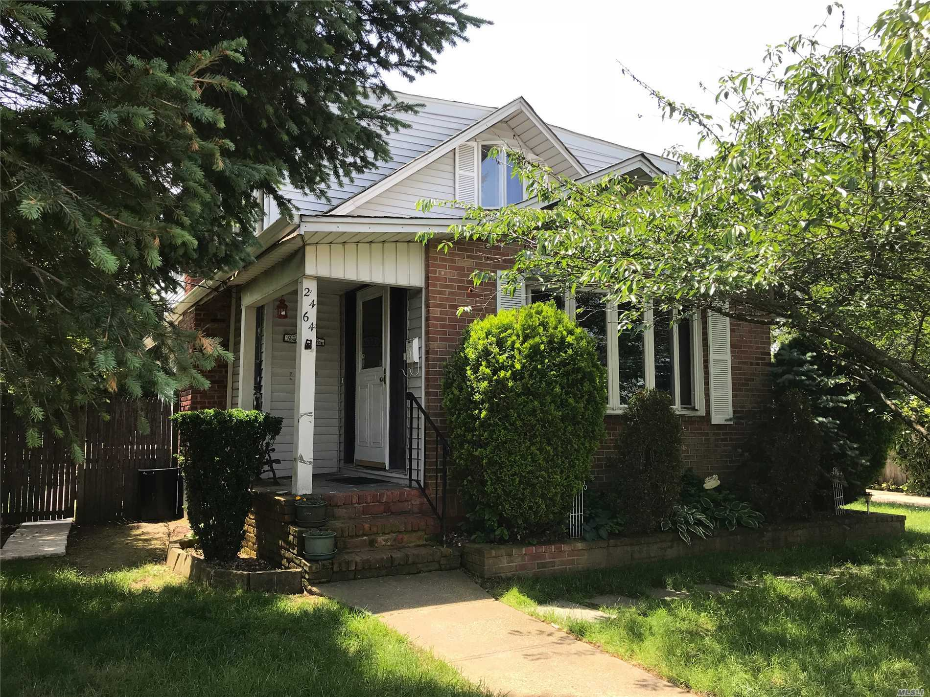 Large Expanded Cape With Detached 2 Car Garage, 4 Zone Heating (Weil Mcclain), Full Finished Basement With Den & Outside Entrance, Large Closets, Vinly & Brick Sided, Landscaped.