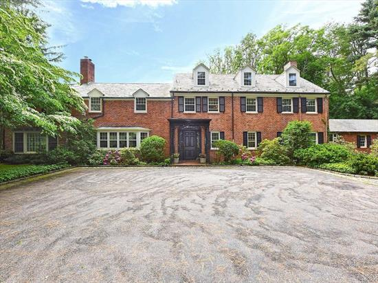 This Elegant Brick Colonial With Slate Roof Is Tucked Away Down A Private Road In An Estate Setting On Over 2 Serene Acres. A Perfect Retreat With Solarium Room That Opens To The Deck Overlooking The In-Ground Gunite Gas Heated Pool And Brick Pool House. Stunning Great Room With Fireplace, Living Room, Office And Den Opens To The Backyard Capturing Bucolic Woodland View. Gas Cooking. Additional 2 Acreage with Tennis Court Available. AS IS!