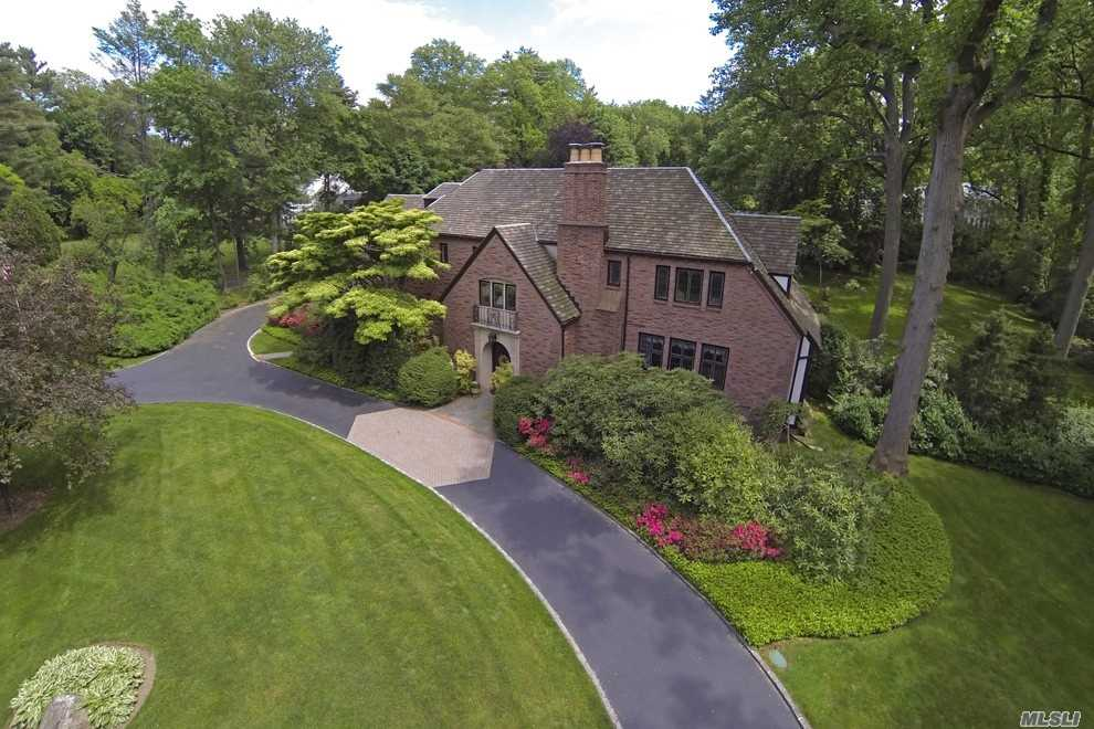 Impressive French Normandy Tudor Set On 1.52 Beautiful Lush Acres W/In-Ground Pool & Cabana In Village Of Flower Hill. Formal Living And Dining Rooms, Eat-In Kitchen, Family Room, Powder Rm And 2nd Staircase Leading To Master Bedroom Suite With Bath Plus 5 Addtl. Bedrooms And 3 Full Baths. Home Districted For Pw Schools But There Is An Easement For Manhasset Schools.