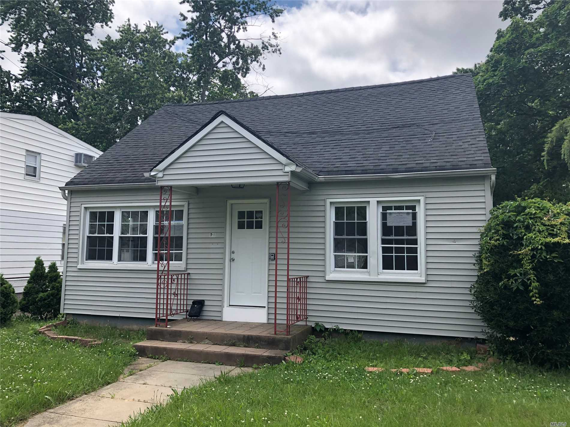 Come See This Great Renovated 4 Bedroom, 1.5 Bath Cape With Full Finished Basement, Wood Floors