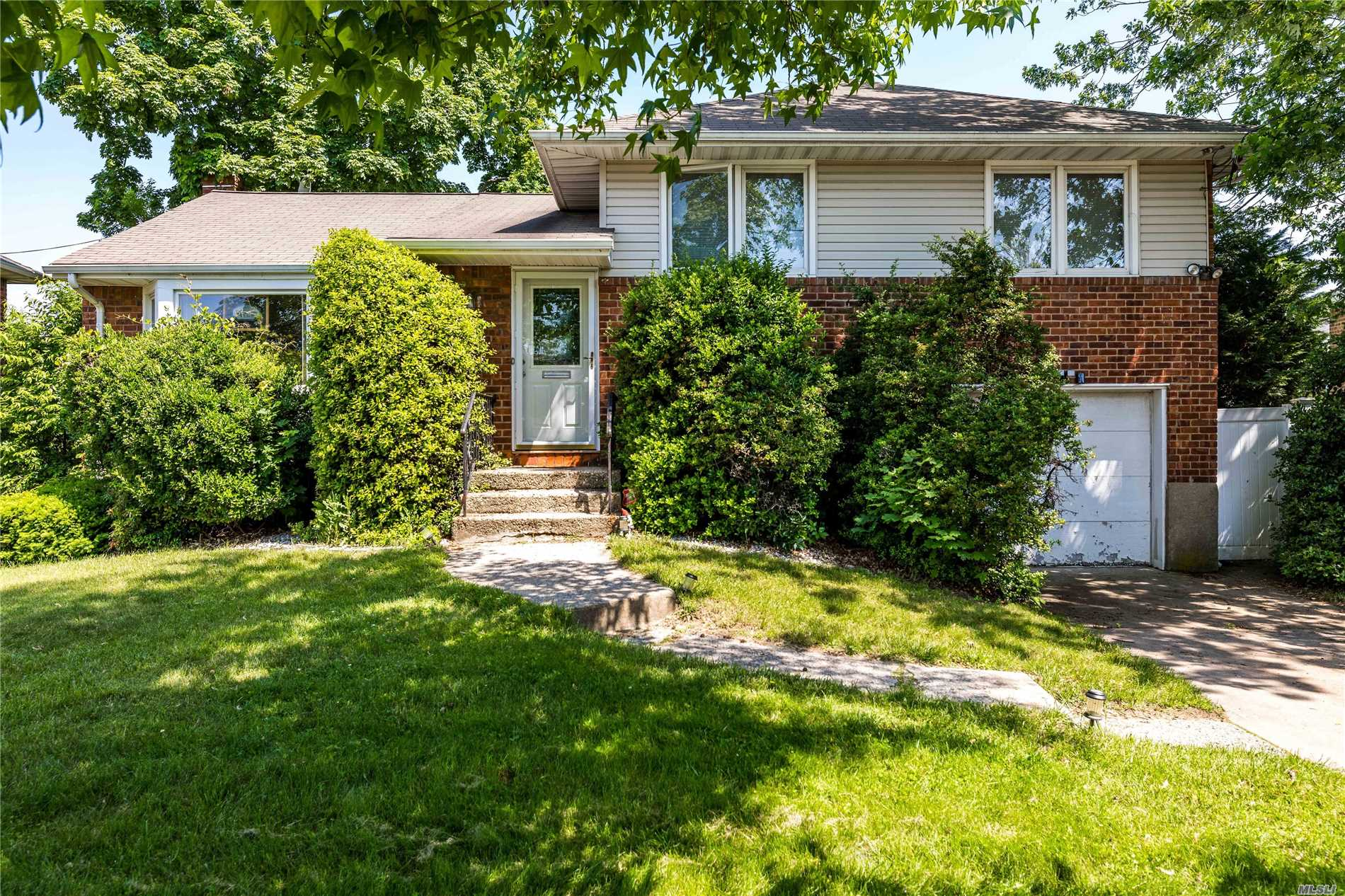 Split Level Home On Low Traffic Street. Close To Shopping And Dining, As Well As Transportation