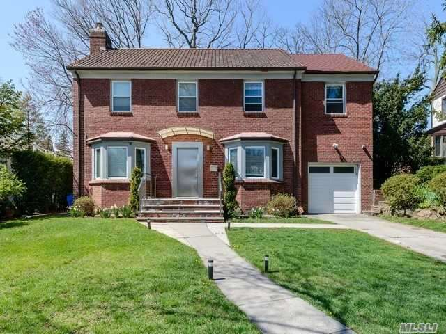 Beautiful Brick Center Hall Colonial Fully Renovated Situated On A Serene Tree Lined St. Featuring Master Suite W/Terrace, 2.5 Baths, Lr W/Fpl, Eik W/Ose, Dinning Area, Family Rm, Full Basement. Entertainers Bkyard. Steps Away From Public Transportation, Express Bus To Nyc. Convenient To All. Zoned For Ps 188.