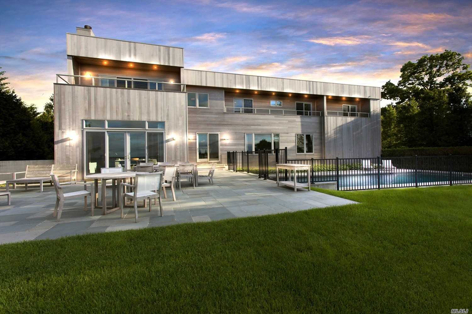 Channeling Vacation Vibes, This Flawless Home, Has 130Ft Of Beach Front, With A 4X70 Dock On Southold Bay, And A Water Side Gunite Pool. All 5 Bedrooms Are En Suite And Have Their Own Teak Balcony's, Featuring Views Of The Bay. There Are 5.5 Bathrooms In Total. A True Eat-In Chief's Kitchen, Soring Ceilings In The Living Room, Upstairs Office/Den, And Full Finished Basement With A Living Room And Bathroom. You Couldn't Ask For Anything More.