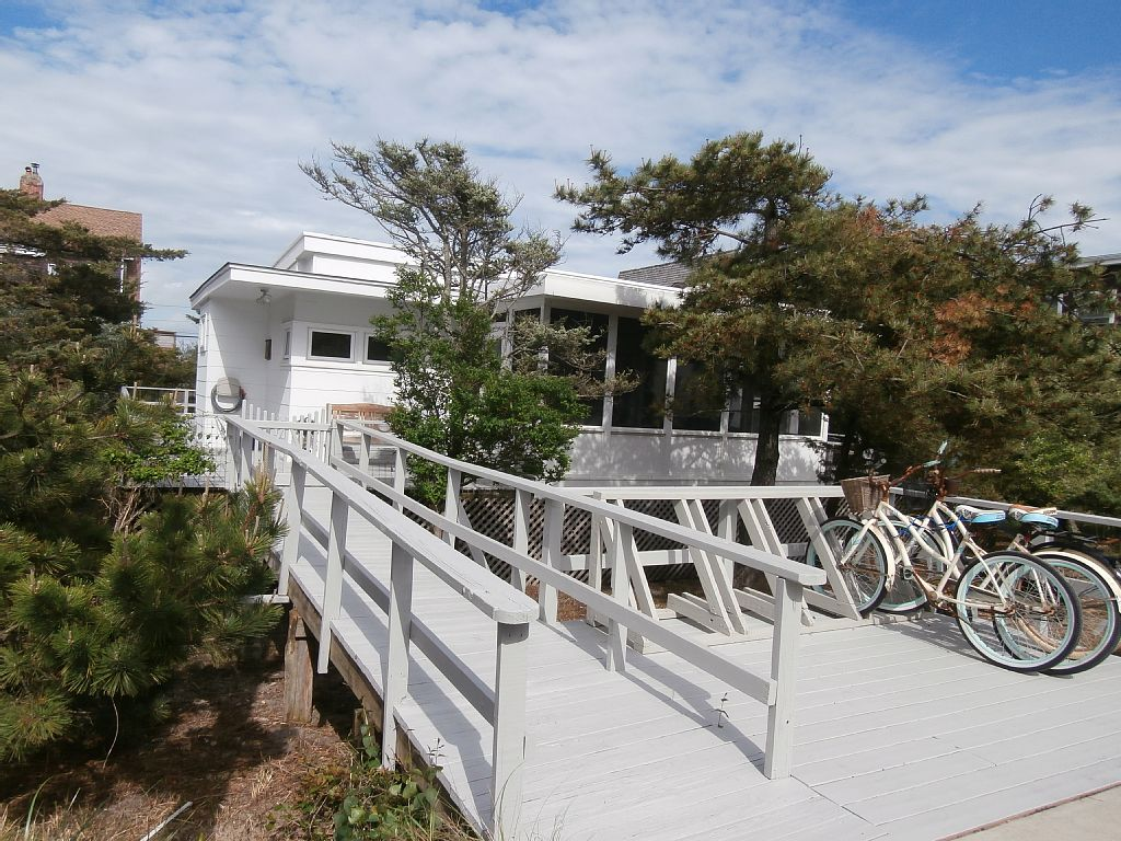 Rare opportunity to own a home just one back from the beach on a great Seaview block.  This bright and airy mid century ranch has 3 bedrooms, 1.5 baths, a charming screened in porch and wraparound deck.  Enjoy this classic home, or build your dream house with stunning Atlantic Ocean views.  Affordable flood insurance, only $829/year!  Here is your chance to live just steps from the beach!  60X100 lot.